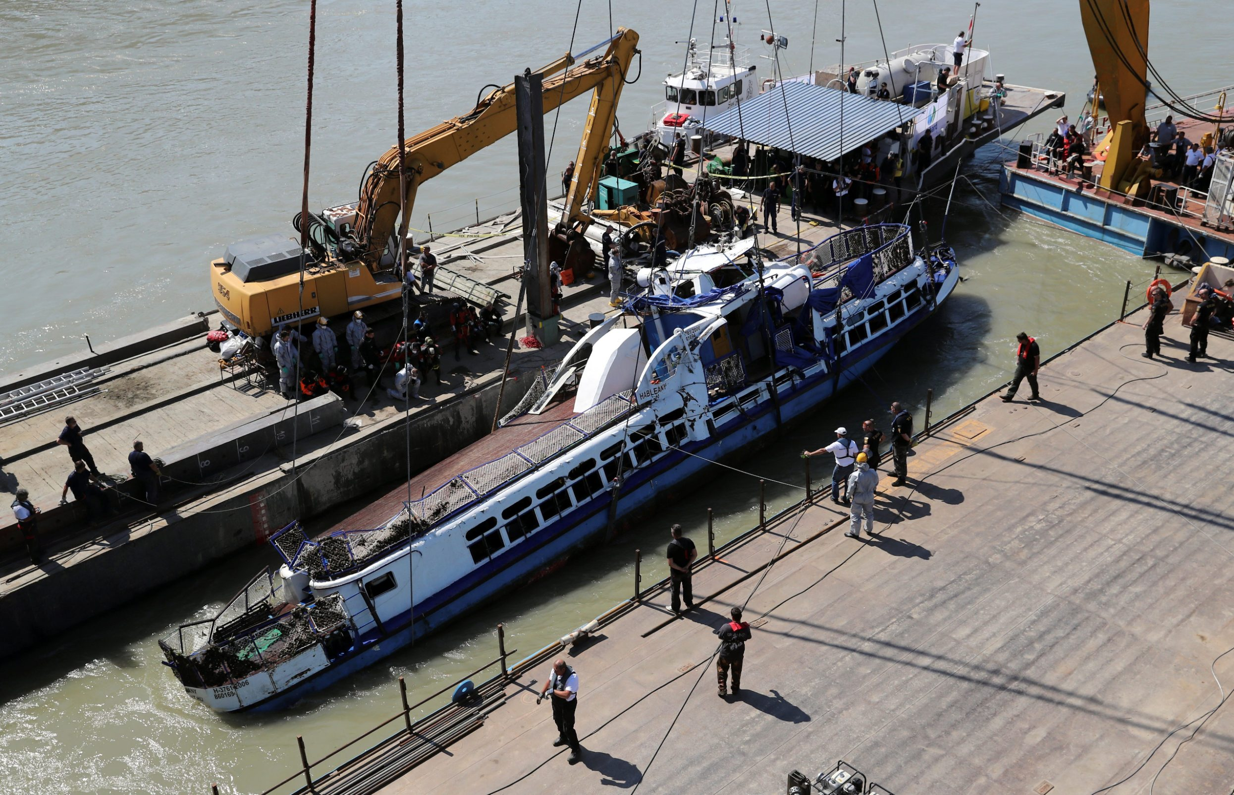 The Mermaid, a Hungarian boat which sank in the Danube river near Margaret bridge, is lifted from the water during a salvage operation in Budapest, Hungary June 11, 2019. REUTERS/Marko Djurica