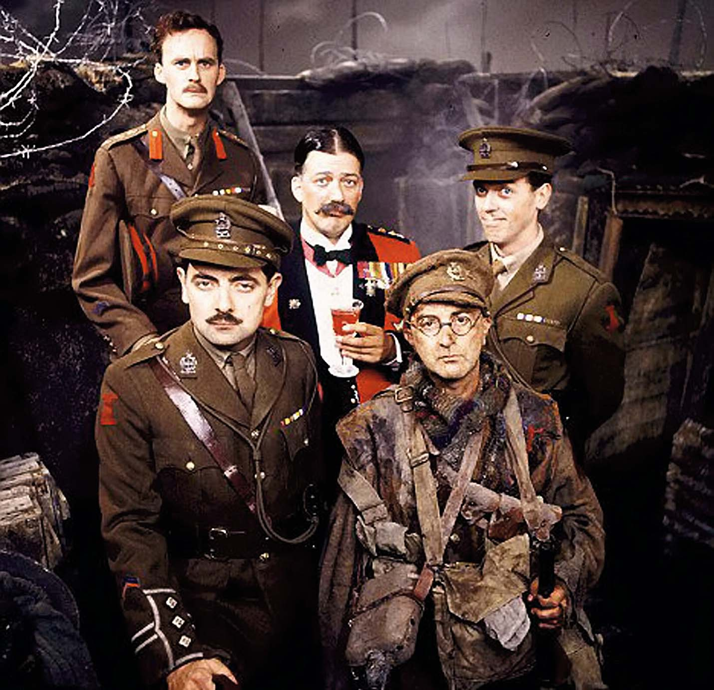 **EMBARGOED UNTIL 12.01AM ON WED 25 JUNE**  Web Grab - Blackadder Goes Forth (1989): The main characters from left front: Captain Blackadder (Rowan Atkinson), Captain Kevin Darling (Tim McInnery), General Melchett (Stephen Fry), Lieutenant George (Hugh Laurie), and Private Baldrick (Tony Robinson).  Captain Blackadder, Lieutenant George and Private Baldrick really did go forth in World War One after it emerged the comedy characters had real-life namesakes.  See NTI story NTIBLACKADDER.  The popular BBC series ran from 1983 until 1989 and ended its run in the trenches with the gang going over the top for