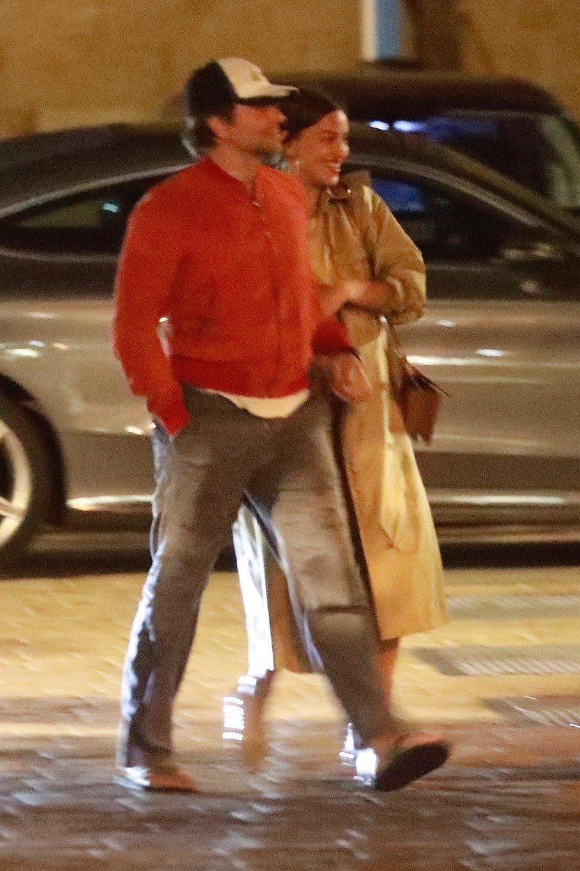 Santa Monica, CA  - *EXCLUSIVE* Bradley Cooper and Irina Shayk walk to their car hand in hand after a romantic, late night dinner date in Santa Monica. The couple appeared happier than ever as they left holding each other and appearing happy and completely engaged in one another. The couple were rumored to be on the verge of a split for months and after rumors swirled that Cooper was in love with his