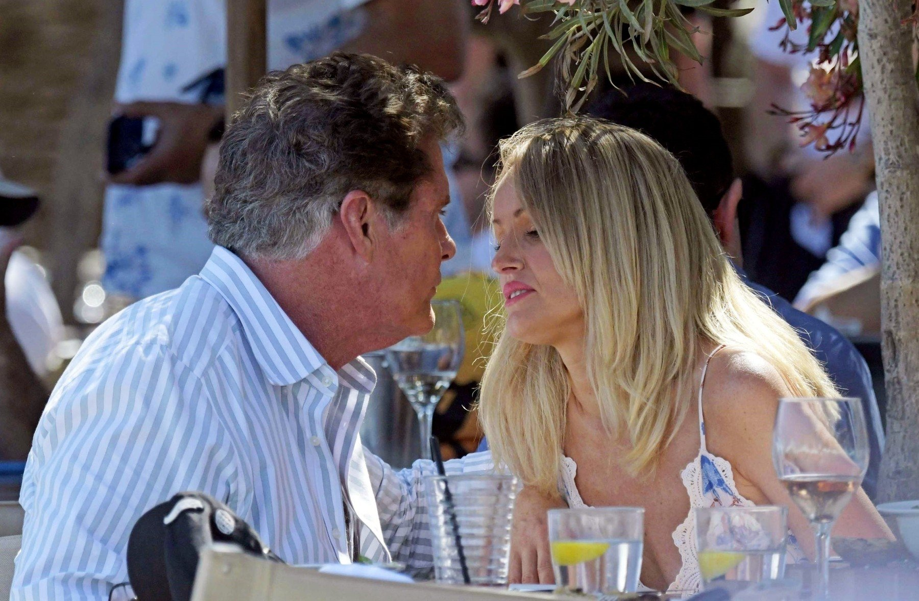 Mykonos, GREECE  - *EXCLUSIVE*  - *WEB MUST CALL FOR PRICING*  Former Knight Rider and Baywatch star David Hasselhoff and wife Hailey Roberts enjoy a romantic meal at Nammos on their Greek holiday in Mykonos.  The couple showed a public display of affection as they enjoyed a kiss at the dining table before walking hand in hand on the beach together.   Hailey wore a sexy floral little number and David was dressed all in white looking cool by donning his sunglasses.   *PICTURES TAKEN ON THE 08/06/19*  *UK Clients - Pictures Containing Children Please Pixelate Face Prior To Publication*, Image: 445705296, License: Rights-managed, Restrictions: RIGHTS:  UNITED STATES, UNITED KINGDOM, AUSTRALIA, MEXICO, CANADA, JAPAN, CHINA, KOREA, DENMARK, RUSSIA, UKRAINE, ESTONIA, LITHUANIA, NORWAY, POLAND, SWEDEN, ANGOLA, BOTSWANA, KENYA, LESOTHO, MALAWI, MAURITIUS, MOZAMBIQUE, NAMIBIA, NIGERIA, SOUTH AFRICA, ZAMBIA, ZIMBABWE, FINLAND, BULGARIA, HUNGARY, ROMANIA, SERBIA, CZECH REPUBLIC, SLOVAKIA, BELARUS, ICELAND, IRELAND, ISRAEL, LATVIA, MOLDOVA, SLOVENIA, SWITZERLAND, COSTA RICA, CUBA, DOMINICA, DOMINICAN REPUBLIC, EL SALVADOR, GRENADA, GUATEMALA, NICARAGUA, PANAMA, PUERTO RICO, NEW ZEALAND, AUSTRIA, CYPRUS, GREECE, BELGIUM, NETHERLANDS, INDIA, INDONESIA, NORTH KOREA, PHILIPPINES, SOUTH KOREA, THAILAND, SAUDI ARABIA, SINGAPORE, TURKEY, UNITED ARAB EMIRATES, BOSNIA, CROATIA, LUXEMBOURG, BAHAMAS, BARBADOS, BELIZE, HAITI, HONDURAS, JAMAICA, SCOTLAND, MONACO, TURKS AND CAICOS ISLANDS, EGYPT, AZERBAIJAN, MALTA, LIBYA, MYANMAR, FRENCH POLYNESIA, TAIWAN, MOROCCO, CAPE VERDE, IVORY COAST, GHANA, MALDIVES, JORDAN, IRAN, SAINT BARTS, SAINT MARTIN, GUADELOUPE, MONTENEGRO, LEBANON, MALAYSIA, FIJI, UGANDA, CURACAO, CHAD, BANGLADESH, VIETNAM, ETHIOPIA, DJIBOUTI, TUNISIA, Model Release: no, Credit line: Profimedia, Backgrid UK