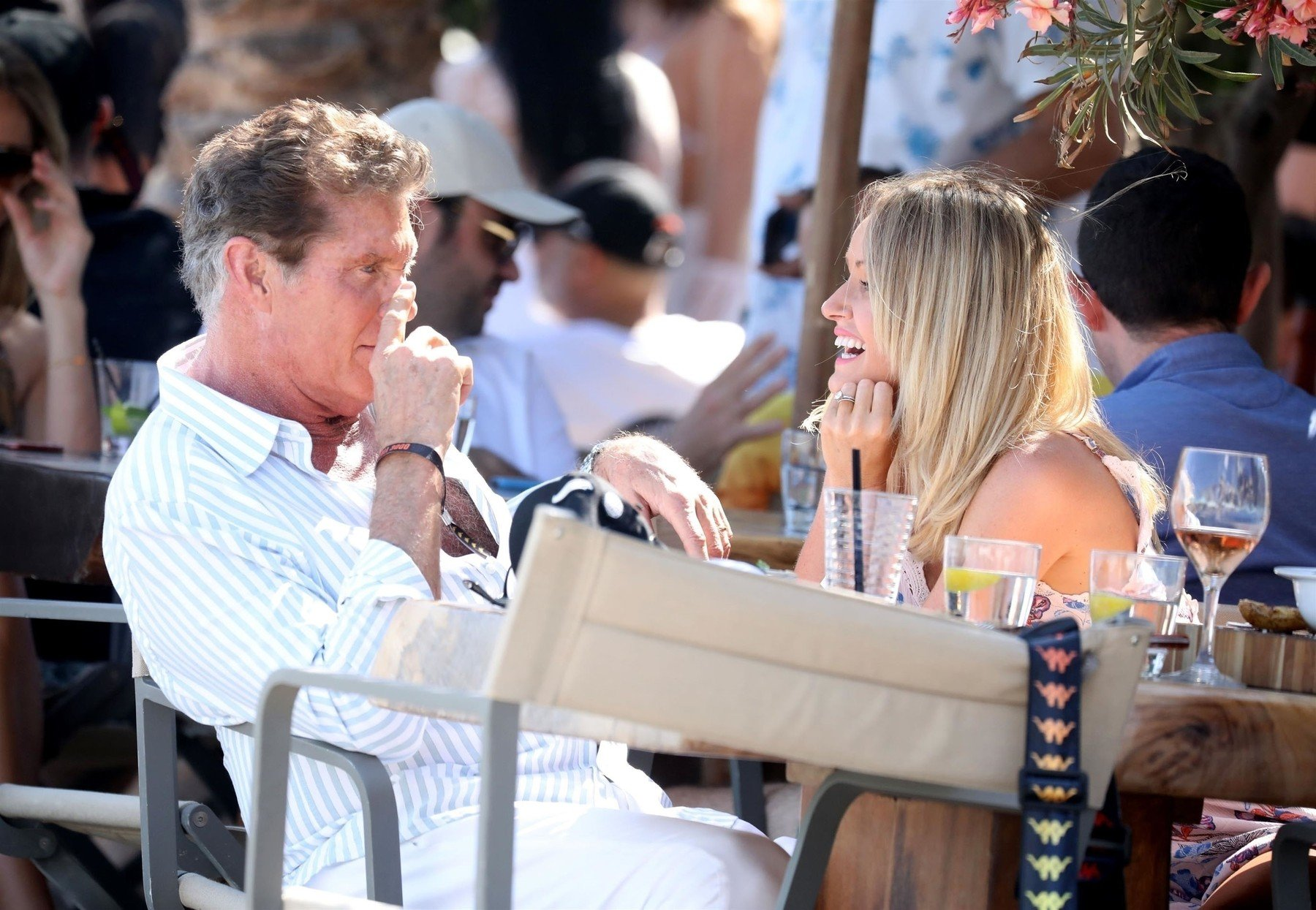 Mykonos, GREECE  - *EXCLUSIVE*  - *WEB MUST CALL FOR PRICING*  Former Knight Rider and Baywatch star David Hasselhoff and wife Hailey Roberts enjoy a romantic meal at Nammos on their Greek holiday in Mykonos.  The couple showed a public display of affection as they enjoyed a kiss at the dining table before walking hand in hand on the beach together.   Hailey wore a sexy floral little number and David was dressed all in white looking cool by donning his sunglasses.   *PICTURES TAKEN ON THE 08/06/19*  *UK Clients - Pictures Containing Children Please Pixelate Face Prior To Publication*, Image: 445705561, License: Rights-managed, Restrictions: RIGHTS:  UNITED STATES, UNITED KINGDOM, AUSTRALIA, MEXICO, CANADA, JAPAN, CHINA, KOREA, DENMARK, RUSSIA, UKRAINE, ESTONIA, LITHUANIA, NORWAY, POLAND, SWEDEN, ANGOLA, BOTSWANA, KENYA, LESOTHO, MALAWI, MAURITIUS, MOZAMBIQUE, NAMIBIA, NIGERIA, SOUTH AFRICA, ZAMBIA, ZIMBABWE, FINLAND, BULGARIA, HUNGARY, ROMANIA, SERBIA, CZECH REPUBLIC, SLOVAKIA, BELARUS, ICELAND, IRELAND, ISRAEL, LATVIA, MOLDOVA, SLOVENIA, SWITZERLAND, COSTA RICA, CUBA, DOMINICA, DOMINICAN REPUBLIC, EL SALVADOR, GRENADA, GUATEMALA, NICARAGUA, PANAMA, PUERTO RICO, NEW ZEALAND, AUSTRIA, CYPRUS, GREECE, BELGIUM, NETHERLANDS, INDIA, INDONESIA, NORTH KOREA, PHILIPPINES, SOUTH KOREA, THAILAND, SAUDI ARABIA, SINGAPORE, TURKEY, UNITED ARAB EMIRATES, BOSNIA, CROATIA, LUXEMBOURG, BAHAMAS, BARBADOS, BELIZE, HAITI, HONDURAS, JAMAICA, SCOTLAND, MONACO, TURKS AND CAICOS ISLANDS, EGYPT, AZERBAIJAN, MALTA, LIBYA, MYANMAR, FRENCH POLYNESIA, TAIWAN, MOROCCO, CAPE VERDE, IVORY COAST, GHANA, MALDIVES, JORDAN, IRAN, SAINT BARTS, SAINT MARTIN, GUADELOUPE, MONTENEGRO, LEBANON, MALAYSIA, FIJI, UGANDA, CURACAO, CHAD, BANGLADESH, VIETNAM, ETHIOPIA, DJIBOUTI, TUNISIA, Model Release: no, Credit line: Profimedia, Backgrid UK