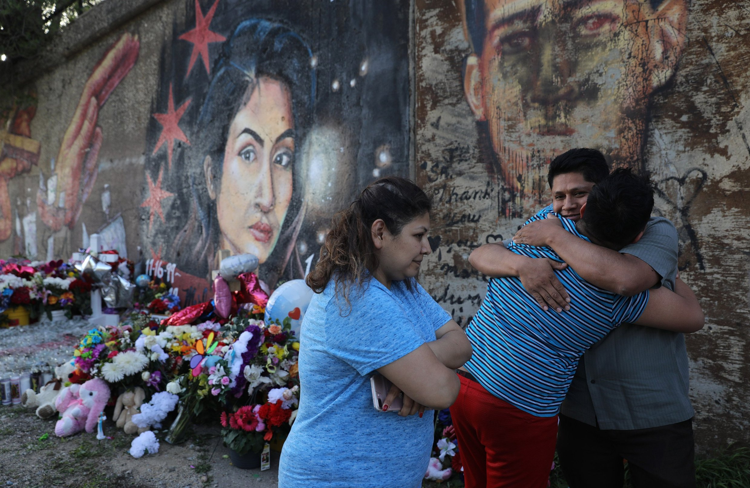 May 22, 2019 - Chicago, IL, USA - Marlen Ochoa-Lopez's father Arnulfo Ochoa gets a surprise hug from his 13-year-old son Oscar, while visiting a mural of Marlen painted by Milton Coronado, in Pilsen, Wednesday, May 22, 2019., Image: 436069735, License: Rights-managed, Restrictions: , Model Release: no, Credit line: Profimedia, Zuma Press - News