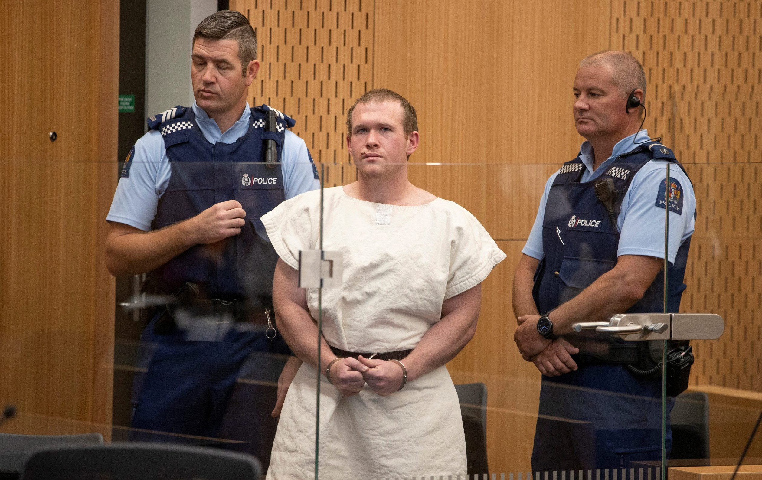 FILE PHOTO: Brenton Tarrant, charged for murder in relation to the mosque attacks, is seen in the dock during his appearance in the Christchurch District Court, New Zealand March 16, 2019. Mark Mitchell/New Zealand Herald/Pool via REUTERS/File Photo