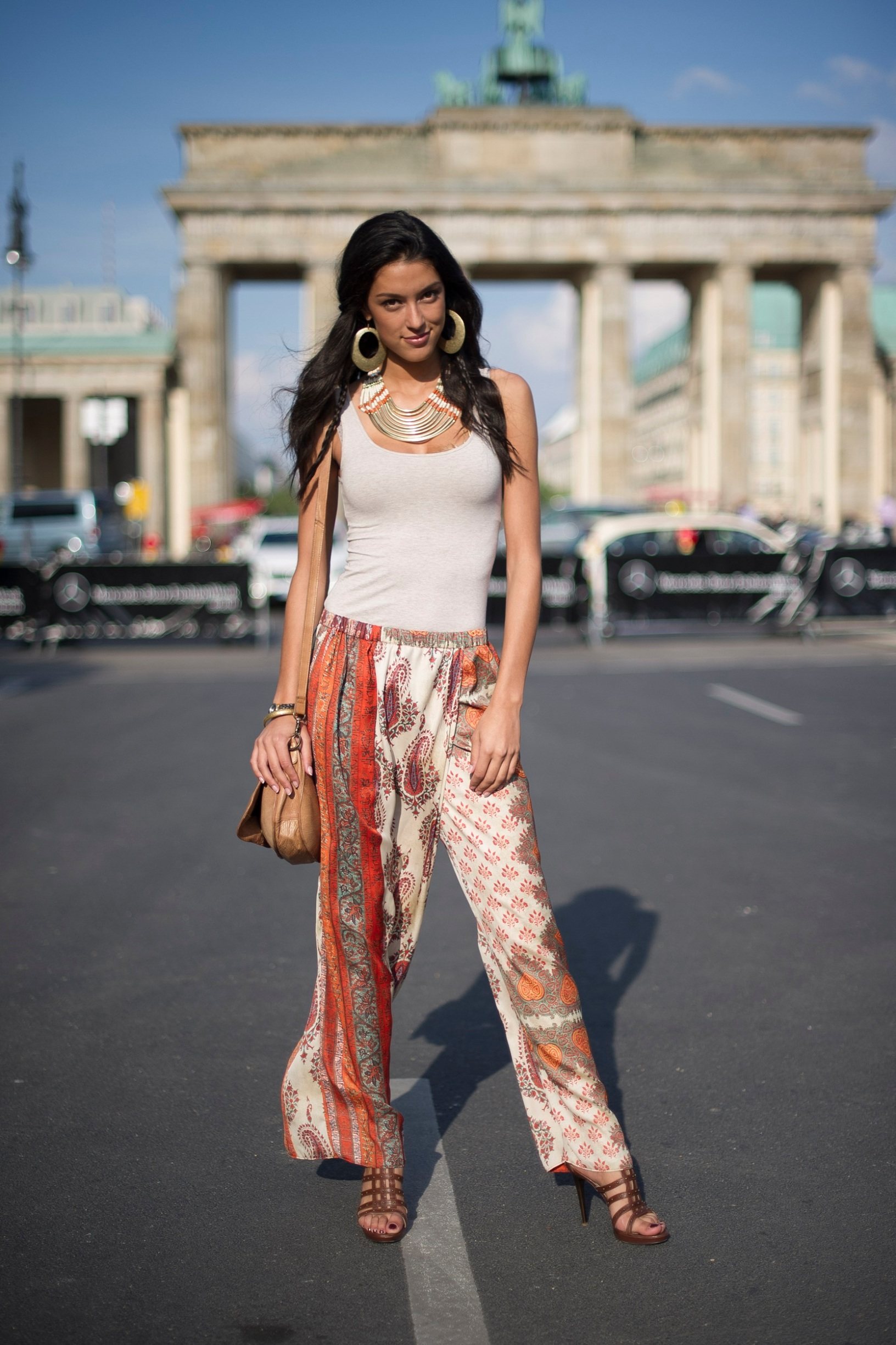 BERLIN, GERMANY - JULY 01:  Rebecca Mir wears shoes from Valentina and pants from Zara as she attends the Mercedes-Benz Fashion week spring and summer 2014 at the Brandenburg Gate on July 1, 2013 in Berlin, Germany.  (Photo by Timur Emek/Getty Images)