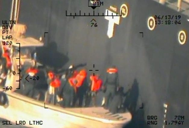 A U.S. military image released by the Pentagon in Washington on June 17, which is says was taken from a U.S. Navy MH-60R helicopter in the Gulf of Oman in waters between Gulf Arab states and Iran on June 13, shows personnel that the Pentagon says are members of the Islamic Revolutionary Guard Corps Navy removing an unexploded limpet mine from the M/T Kokuka Courageous, a Japanese owned commercial motor tanker. Picture taken June 13, 2019.  U.S. Navy/Handout via REUTERS   ATTENTION EDITORS-THIS IMAGE HAS BEEN SUPPLIED BY A THIRD PARTY.