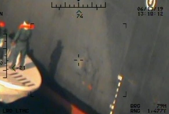 A U.S. military image released by the Pentagon in Washington on June 17, which is says was taken from a U.S. Navy MH-60R helicopter in the Gulf of Oman in waters between Gulf Arab states and Iran on June 13, shows personnel that the Pentagon says are members of the Islamic Revolutionary Guard Corps Navy leaving after removing an unexploded limpet mine from the M/T Kokuka Courageous, a Japanese owned commercial motor tanker. Picture taken June 13, 2019.  U.S. Navy/Handout via REUTERS   ATTENTION EDITORS-THIS IMAGE HAS BEEN SUPPLIED BY A THIRD PARTY.