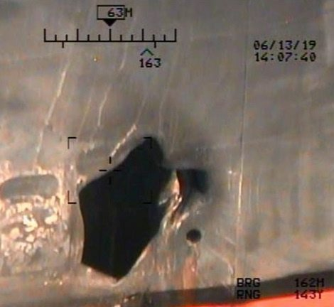 A U.S. military image released by the Pentagon in Washington on June 17, which is says was taken from a U.S. Navy MH-60R helicopter in the Gulf of Oman in waters between Gulf Arab states and Iran on June 13, shows mine blast damage to M/T Kokuka Courageous, a Japanese owned commercial motor tanker. Picture taken June 13, 2019.  U.S. Navy/Handout via REUTERS   ATTENTION EDITORS-THIS IMAGE HAS BEEN SUPPLIED BY A THIRD PARTY.