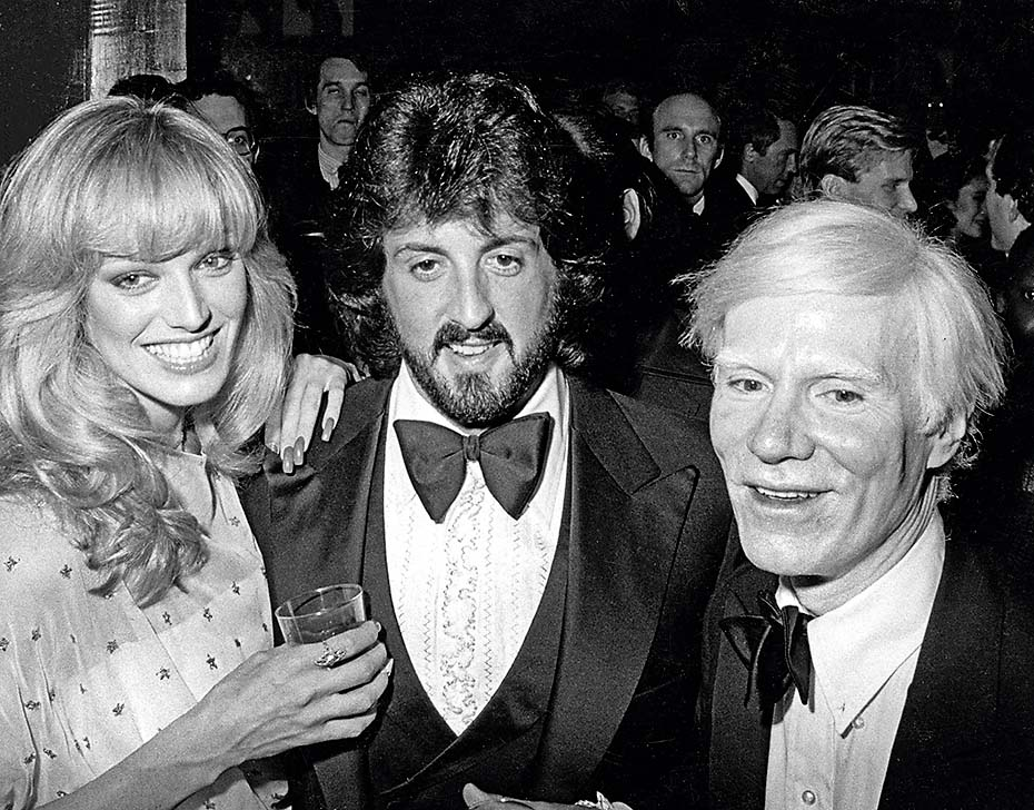 Susan Anton, Sylvestor Stallone, and Andy Warhol during Andy Warhol Exhibit Opening - November 20, 1979 at Whitney Museum in New York City, New York, United States. (Photo by Ron Galella/Ron Galella Collection via Getty Images)
