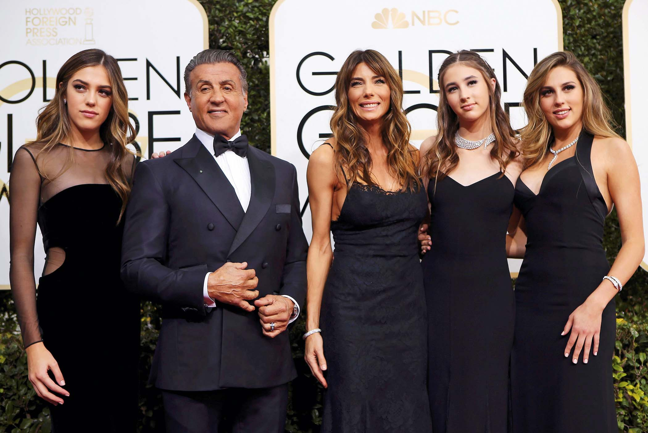 Actor Sylvester Stallone poses with his wife Jennifer Flavin (C), and their daughters, 2017 Miss Golden Globe Sistine Stallone (L), Scarlet Stallone (2nd R) and Sophia Stallone during the 74th Annual Golden Globe Awards in Beverly Hills, California, U.S., January 8, 2017.   REUTERS/Mike Blake     TPX IMAGES OF THE DAY - RC1C5D5BA8A0
