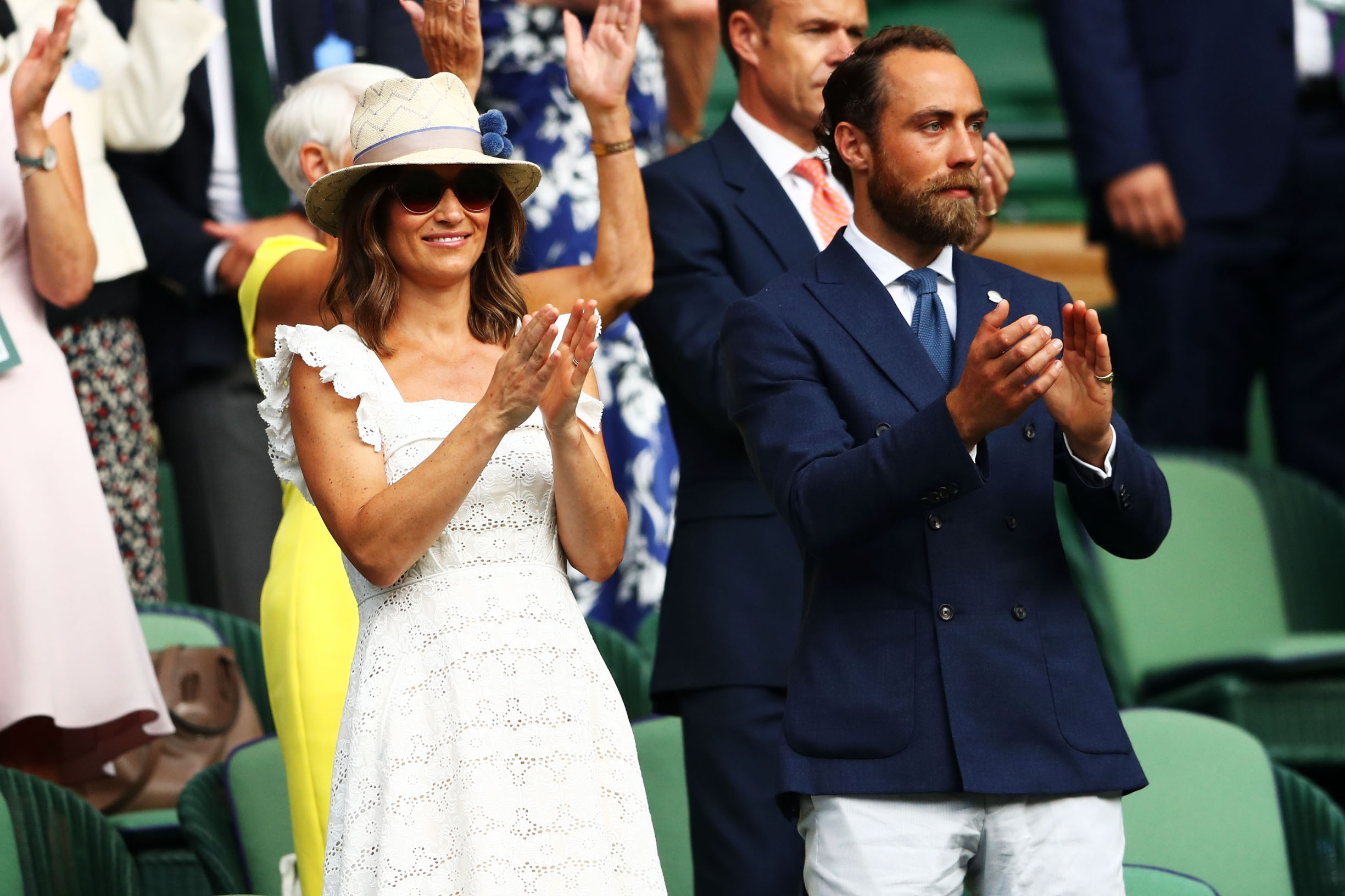 LONDON, ENGLAND - JULY 05:  (L-R) Pippa Middleton and James Middleton applaud Kyle Edmund of Great Britain defeating Bradley Klahn of the United States during in the Men's Singles second round match on day four of the Wimbledon Lawn Tennis Championships at All England Lawn Tennis and Croquet Club on July 5, 2018 in London, England.  (Photo by Michael Steele/Getty Images)