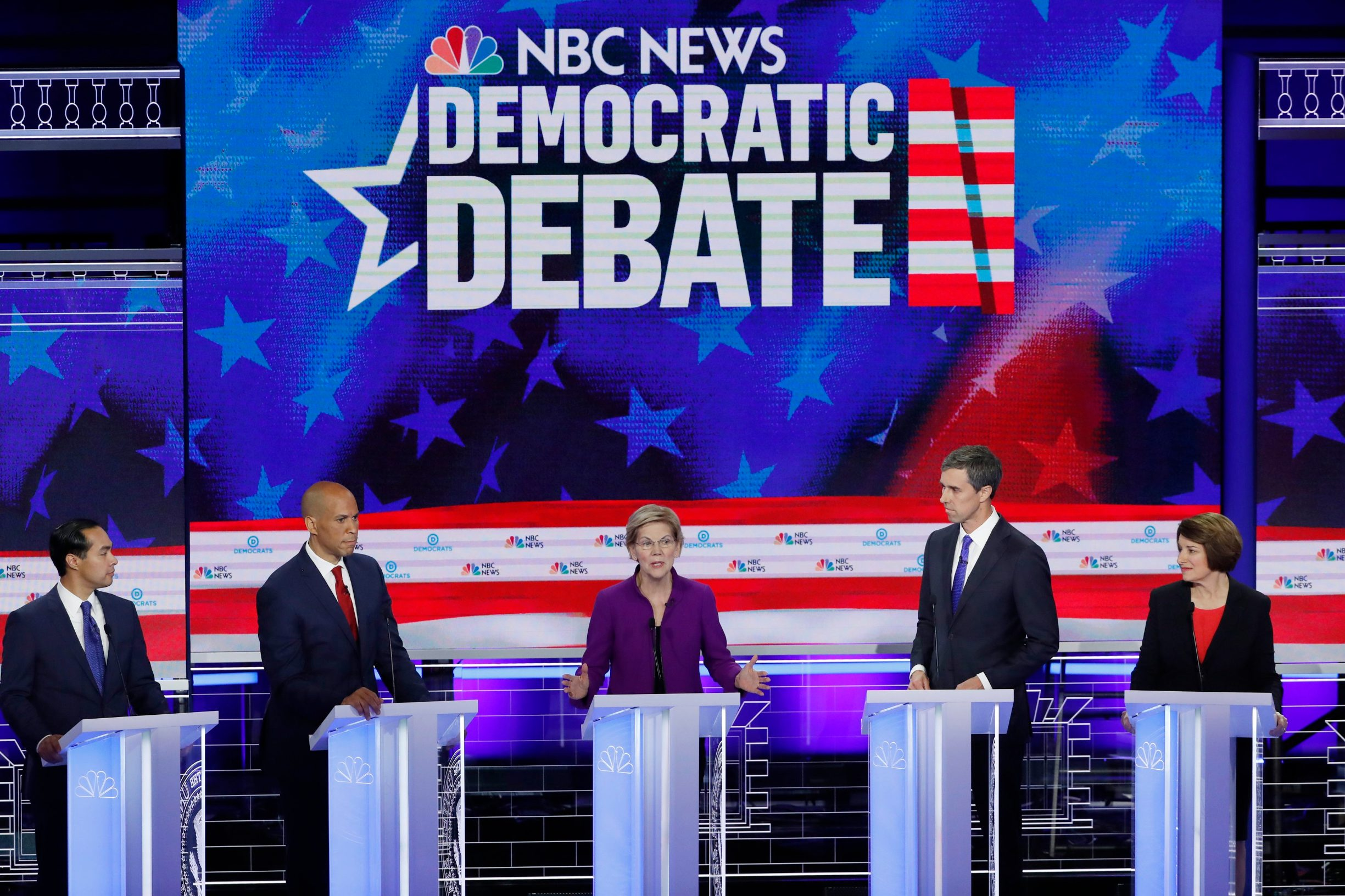2019-06-27T032624Z_1075011770_HP1EF6R09K0HG_RTRMADP_3_USA-ELECTION-DEBATE