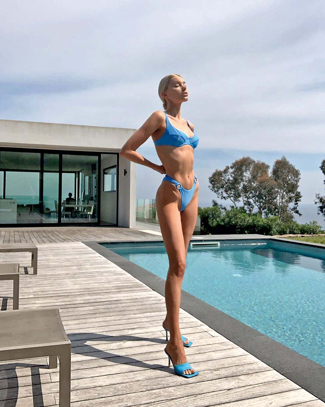 Non Exclusive: Elsa Hosk relaxes by her pool as she enjoys a French morning. The model showed off her stunning figure as she posed in a blue bikini and slipped on some high heeled shoes as she lay by her swimming pool in the Cannes sunshine.  -------  DISCLAIMER:  BEEM does not claim any Copyright or License in the attached material. Any downloading fees charged by BEEM are for BEEM's services only, and do not, nor are they intented to, convey to the user any Copyright or License in the material. By publshing this material, the user expressly agrees to indemnify and to hold BEEM harmless from any claims, demands, or causes of action arising out of or connected in any way with user's publication of the material., Image: 437465129, License: Rights-managed, Restrictions: MANDATORY CREDIT OR DOUBLE FEE WILL BE CHARGED, Model Release: no, Credit line: Profimedia, Beem