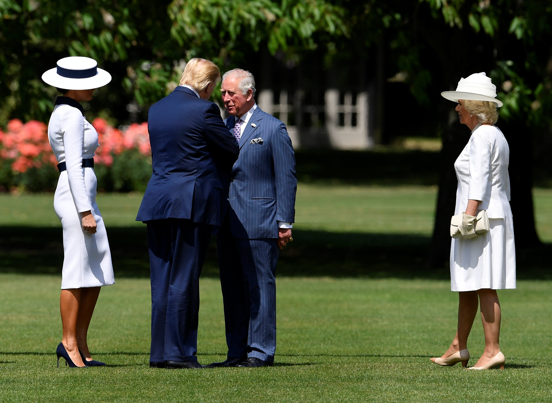 LONDON, ENGLAND - JUNE 03:  US President Donald Trump and First Lady Melania Trump are greeted by Camilla, Duchess of Cornwall and Prince Charles, Prince of Wales on June 3, 2019 in London, England. President Trump's three-day state visit will include lunch with the Queen, and a State Banquet at Buckingham Palace, as well as business meetings with the Prime Minister and the Duke of York, before travelling to Portsmouth to mark the 75th anniversary of the D-Day landings.  (Photo by Toby Melville - WPA Pool/Getty Images)