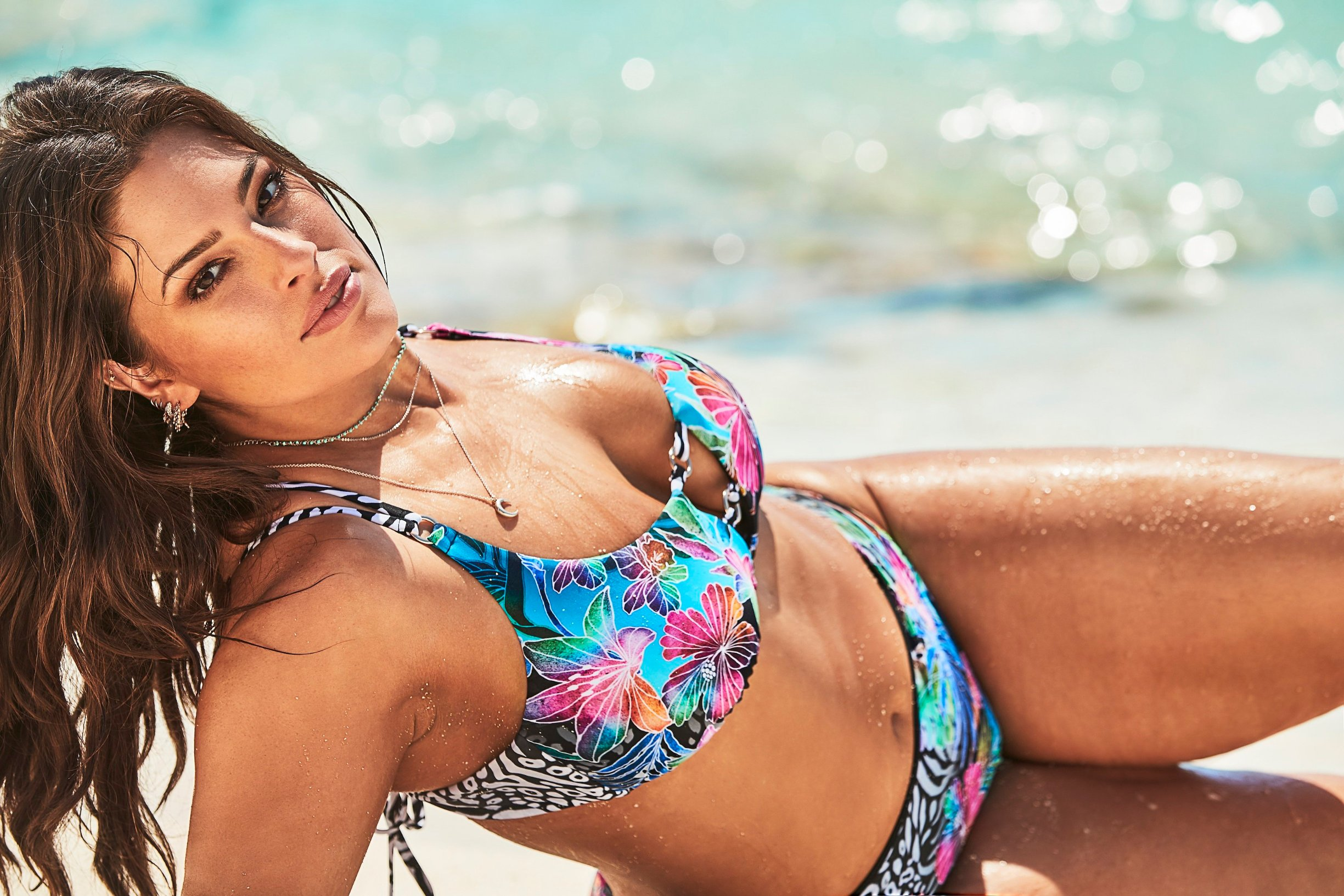 Ashley Graham proudly shows off her voluptuous figure alongside her sister in the new Swimsuits For All summer collection. The 31-year-old plus-size model is joined by her younger sister Abigail in the summery beach photoshoot, where the pair are seen cavorting together in the surf.  The new capsule collection celebrates the immeasurable relationship, unconditional support, and encouragement that is shared among Ashley and her sister Abigail, according to the brand and the campaign was shot on the beaches ofPunta Cana, in the Dominican Republic. The campaign captures their sisterly bond through a series of
