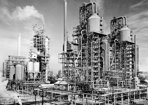 Photograph of three (then) new catalytic oil 'cracking' units are turning out gasoline for the new machines of war at the plant of a large U.S. refining company in the southern U.S. state of Louisiana. Dated 1944. (Photo by: Photo12/UIG via Getty Images)