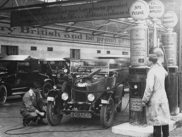 Morris Cowley Bullnose in a garage, 1925. An attendant checks the air pressure in the tyres. Another man in overalls stands next to a petrol pump. The Morris Bullnose displaced the Model T Ford as the best-selling car on the British market. (Photo by National Motor Museum/Heritage Images/Getty Images)