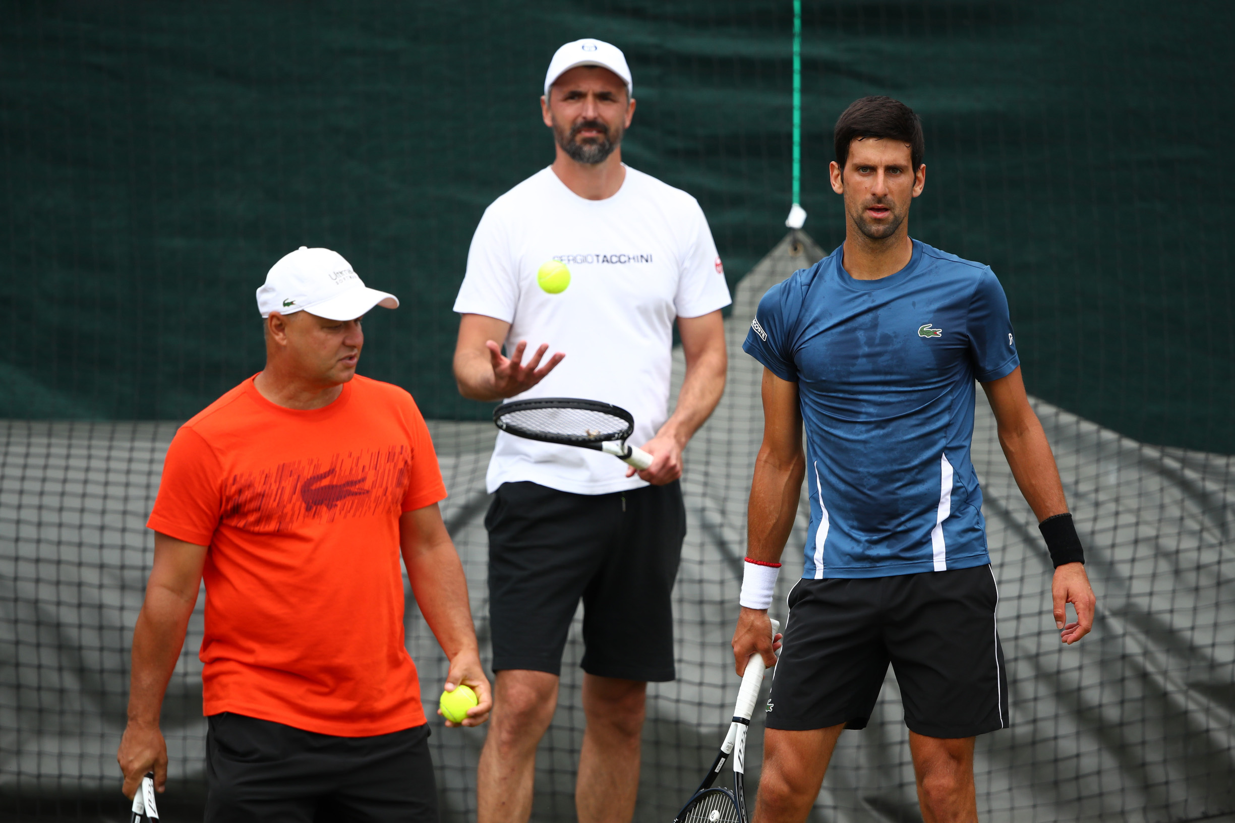 LONDON, ENGLAND - JUNE 30: (L-R) Marian Vajda, Goran Ivanisevic and Novak Djokovic of Serbia look on during a practice session ahead of The Championships - Wimbledon 2019 at All England Lawn Tennis and Croquet Club on June 30, 2019 in London, England. (Photo by Clive Brunskill/Getty Images)