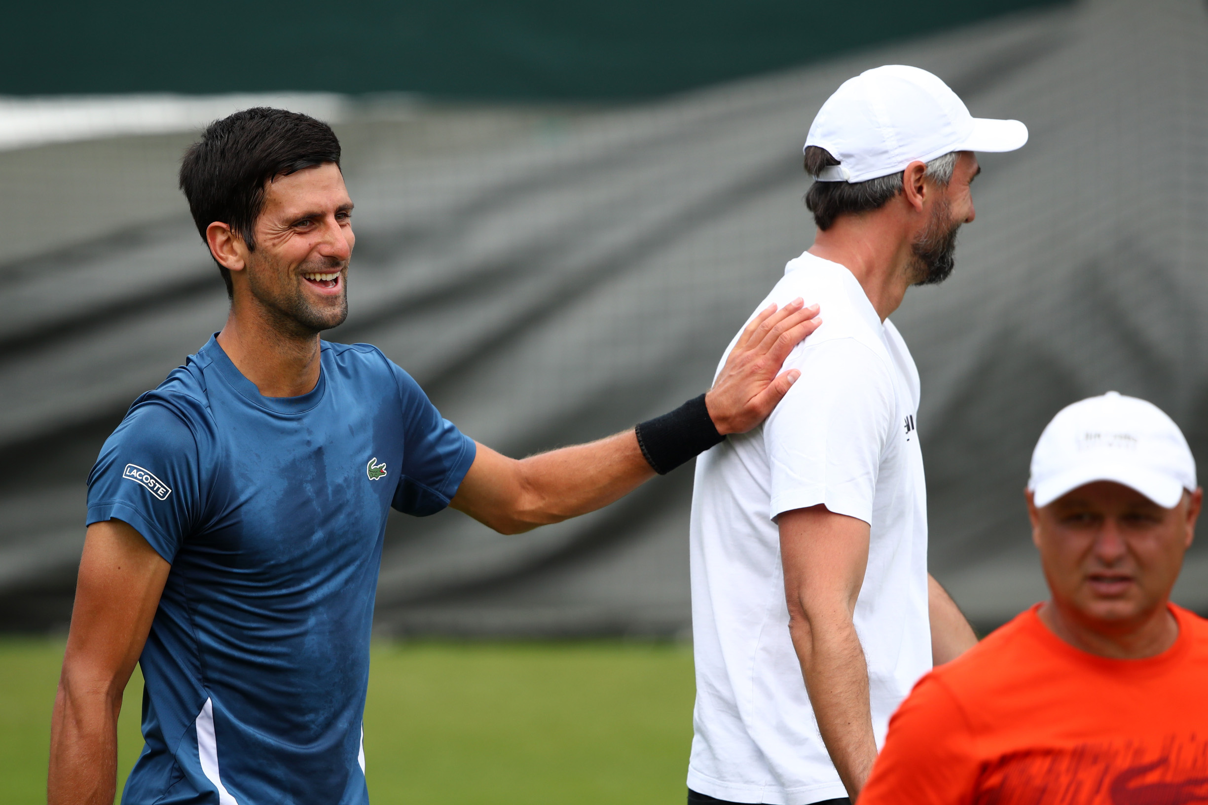LONDON, ENGLAND - JUNE 30: Novak Djokovic of Serbia (L) speaks with Goran Ivanisevic during a practice session ahead of The Championships - Wimbledon 2019 at All England Lawn Tennis and Croquet Club on June 30, 2019 in London, England. (Photo by Clive Brunskill/Getty Images)