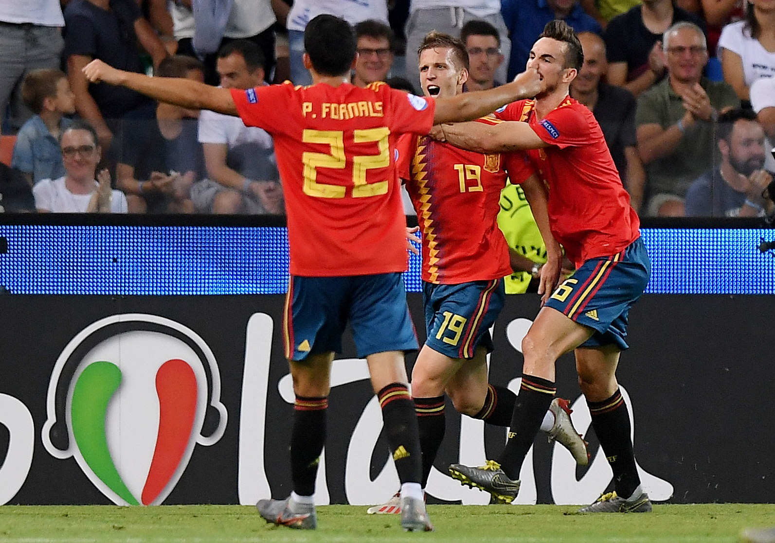 Soccer Football - 2019 UEFA European Under-21 Championship - Final - Spain v Germany - Dacia Arena, Udine, Italy - June 30, 2019  Spain's Dani Olmo celebrates scoring their second goal with Fabian Ruiz and Pablo Fornals   REUTERS/Alberto Lingria