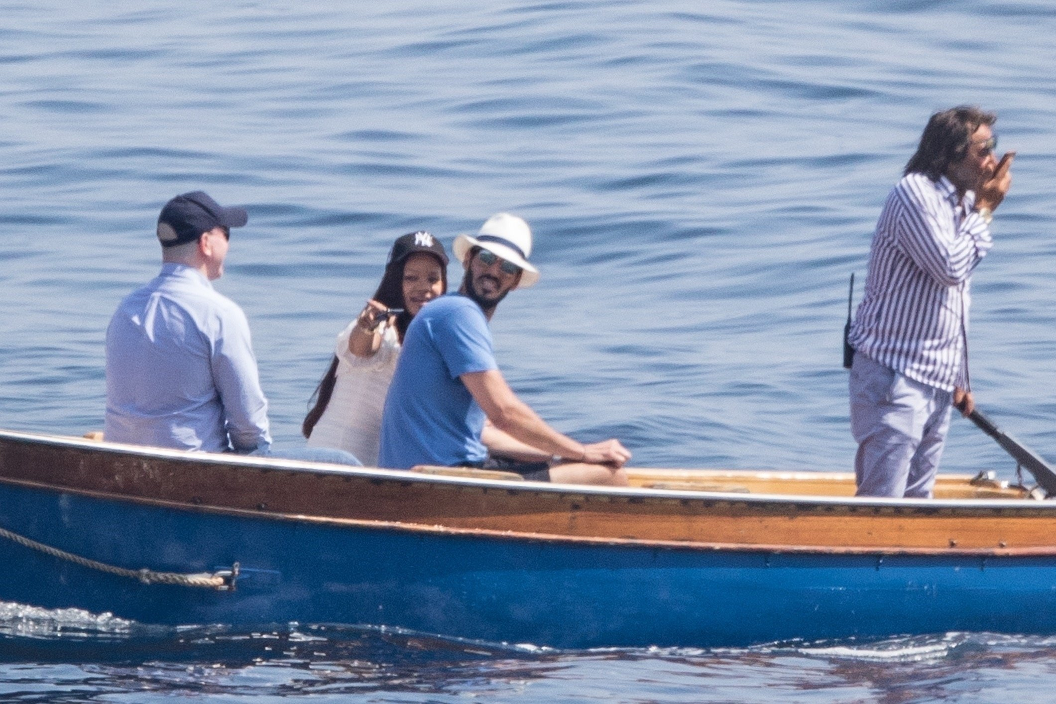 NAPLES, ITALY  - *PREMIUM-EXCLUSIVE*  - MUST CALL FOR PRICING BEFORE USAGE  -STRICTLY NOT AVAILABLE FOR ONLINE USAGE UNTIL 23:00 PM UK TIME ON 06/06/2019 -   Rihanna totally loved up as she holidays with her billionaire boyfriend Hassan Jameel and his family in Italy !!    The loved up couple stopped for lunch at the restaurant