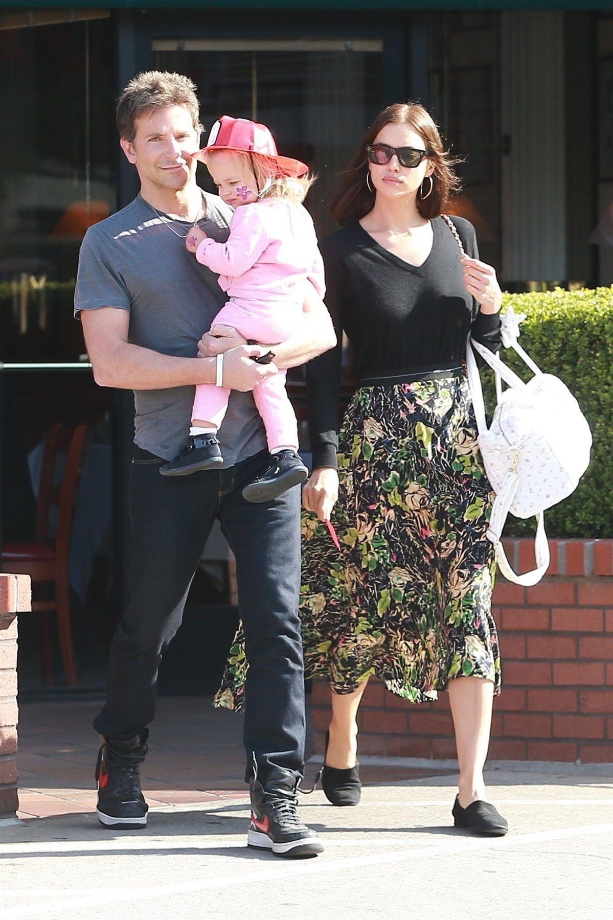 Santa Monica, CA  - Bradley Cooper and Irina Shayk leave a birthday party with their little firefighter Lea in Santa Monica. The Russian supermodel makes simple stylish in a black v-neck top with a floral print dress and matching black flats, for her outing with loved ones ahead of Thanksgiving.  Pictured: Bradley Cooper, Irina Shayk, Lea De Seine Shayk Cooper    *UK Clients - Pictures Containing Children Please Pixelate Face Prior To Publication*, Image: 397591344, License: Rights-managed, Restrictions: , Model Release: no, Credit line: Profimedia, Backgrid USA