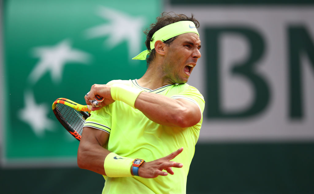 PARIS, FRANCE - JUNE 09: Rafael Nadal of Spain plays a forehand during the mens singles final against Dominic Thiem of Austria during Day fifteen of the 2019 French Open at Roland Garros on June 09, 2019 in Paris, France. (Photo by Julian Finney/Getty Images)