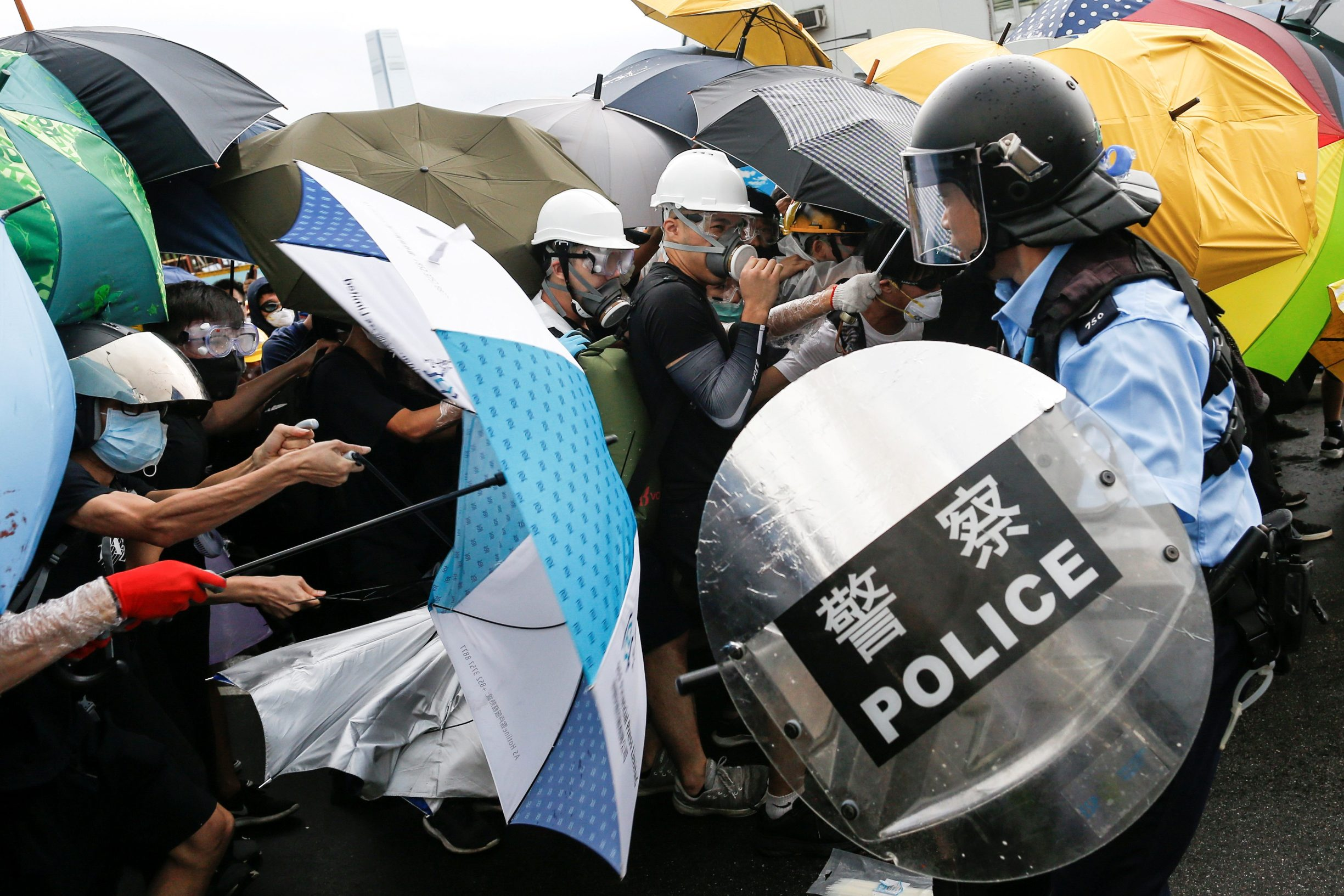 Police try to disperse protesters near a flag raising ceremony for the anniversary of Hong Kong handover to China in Hong Kong, China July 1, 2019.  REUTERS/Thomas Peter     TPX IMAGES OF THE DAY