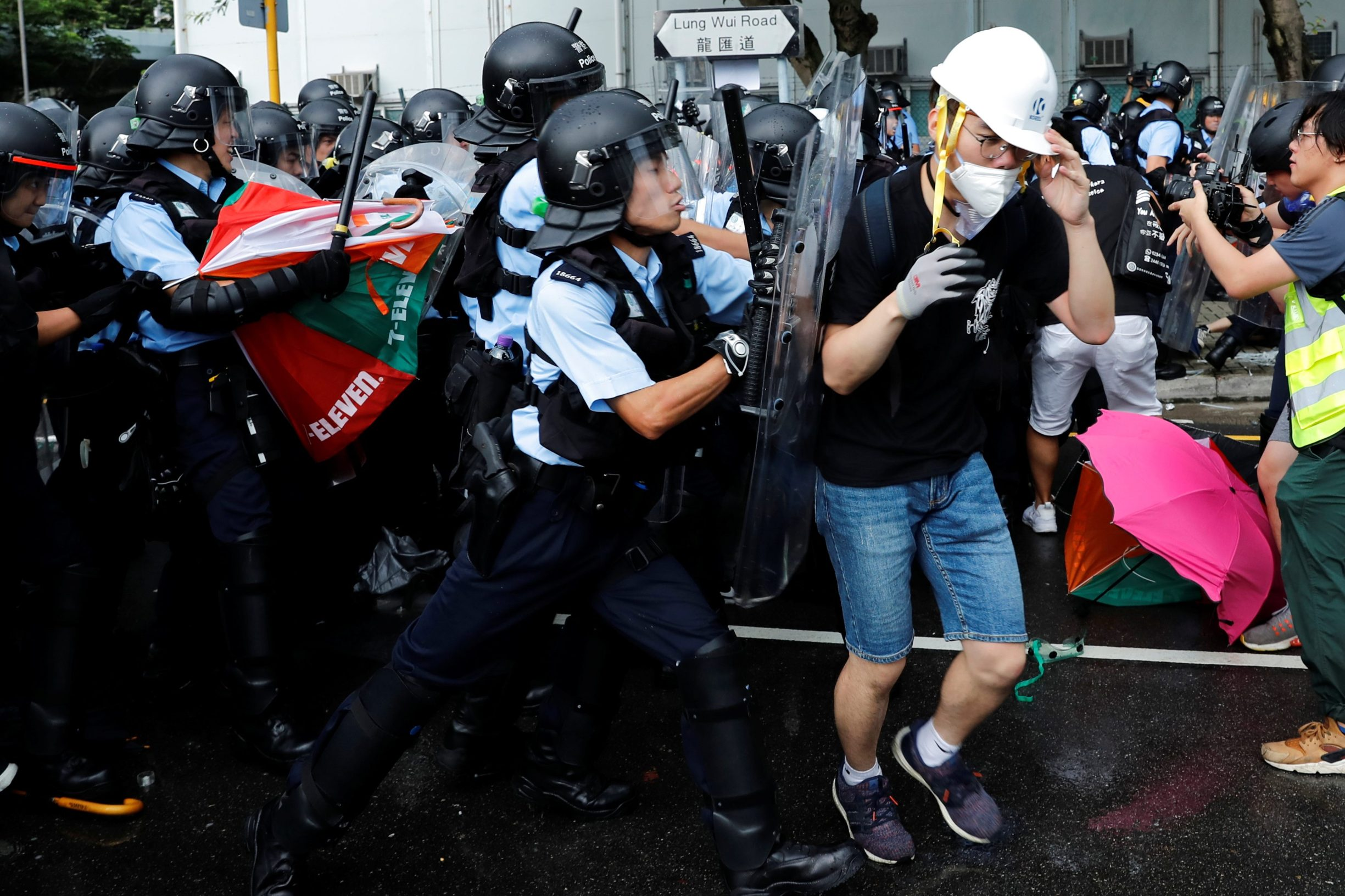 Police try to disperse protesters near a flag raising ceremony for the anniversary of Hong Kong handover to China in Hong Kong, China July 1, 2019. REUTERS/Tyrone Siu