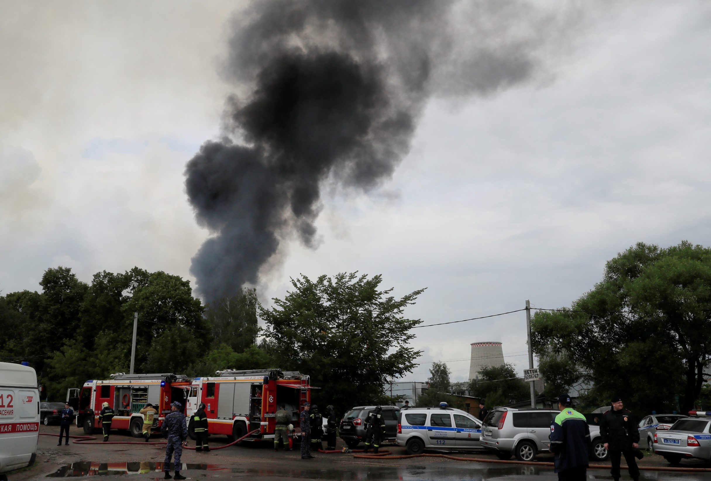 Emergency services work near the site of a fire at an electricity generating power station in Moscow region, Russia July 11, 2019. REUTERS/Tatyana Makeyeva