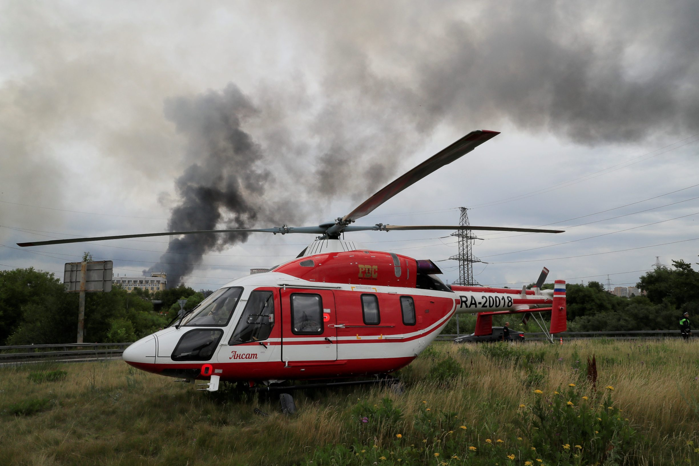 A helicopter of the Russian Emergencies Ministry is seen near the site of a fire at an electricity generating power station in Moscow region, Russia July 11, 2019. REUTERS/Tatyana Makeyeva