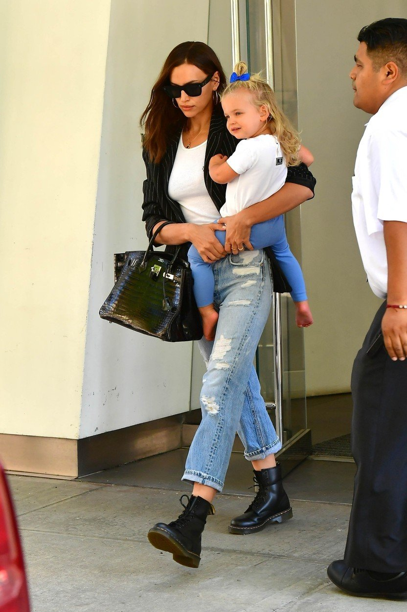 BROOKLYN, Ny  - Irina Shayk is seen stepping out with her daughter Lea in NYC. The model who has reportedly split from Bradley Cooper was seen wearing a trinity ring on her left hand as she headed out in jeans, a white T and doc martens.  BACKGRID USA 1 JULY 2019, Image: 453314206, License: Rights-managed, Restrictions: RIGHTS: WORLDWIDE EXCEPT IN FRANCE, GERMANY, POLAND, Model Release: no, Credit line: Profimedia, Backgrid USA