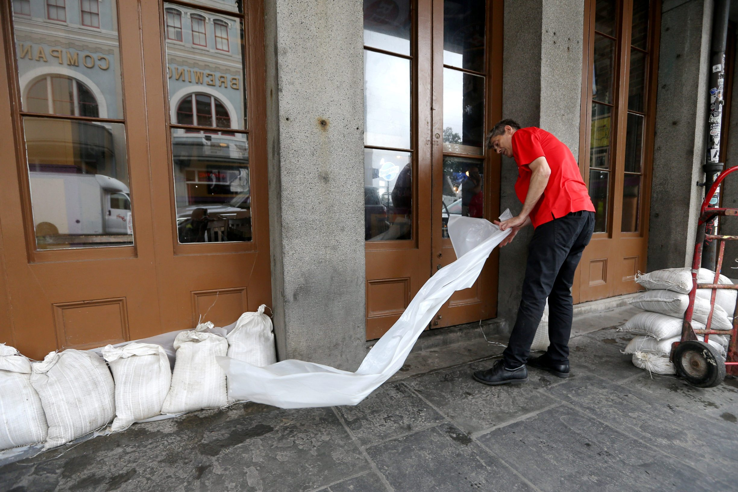 An employee places sandbags in front of a business in the French Quarter as Tropical Storm Barry approaches land in New Orleans, Louisiana, U.S. July 12, 2019.  REUTERS/Jonathan Bachman
