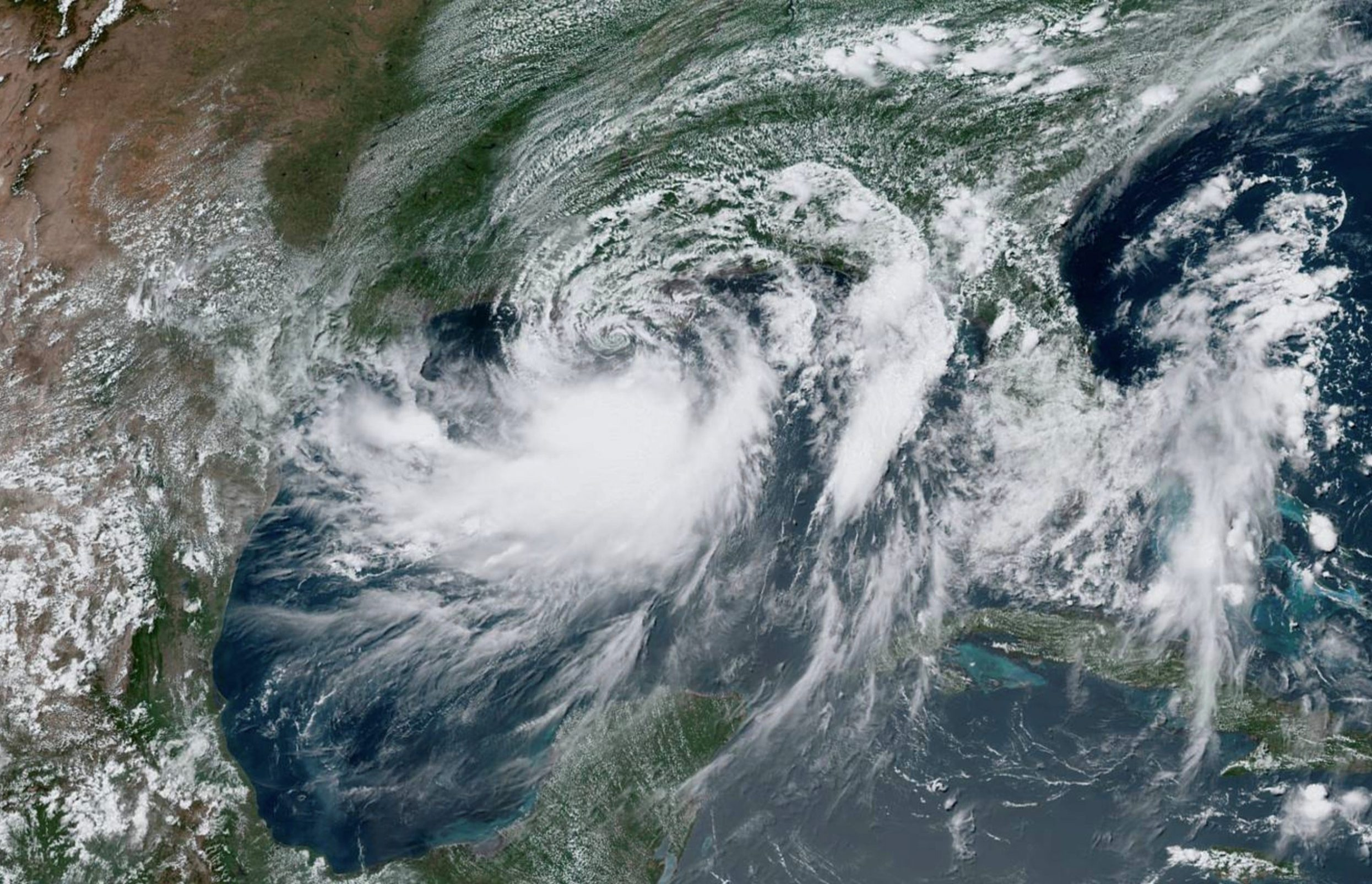 Tropical Storm Barry approaches the coast of Louisiana, U.S. from the Gulf of Mexico in this July 12, 2019 satellite handout photo.  NOAA/Handout via REUTERS ATTENTION EDITORS - THIS IMAGE WAS PROVIDED BY A THIRD PARTY.