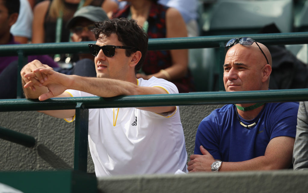 LONDON, ENGLAND - JULY 12:  Coaching staff of Novak Djokovic, Mario Ancic (L) and Andre Agassi look on during his Gentlemen's Singles quarter final match against Tomas Berdych of The Czech Republic on day nine of the Wimbledon Lawn Tennis Championships at the All England Lawn Tennis and Croquet Club on July 12, 2017 in London, England.  (Photo by Julian Finney/Getty Images)