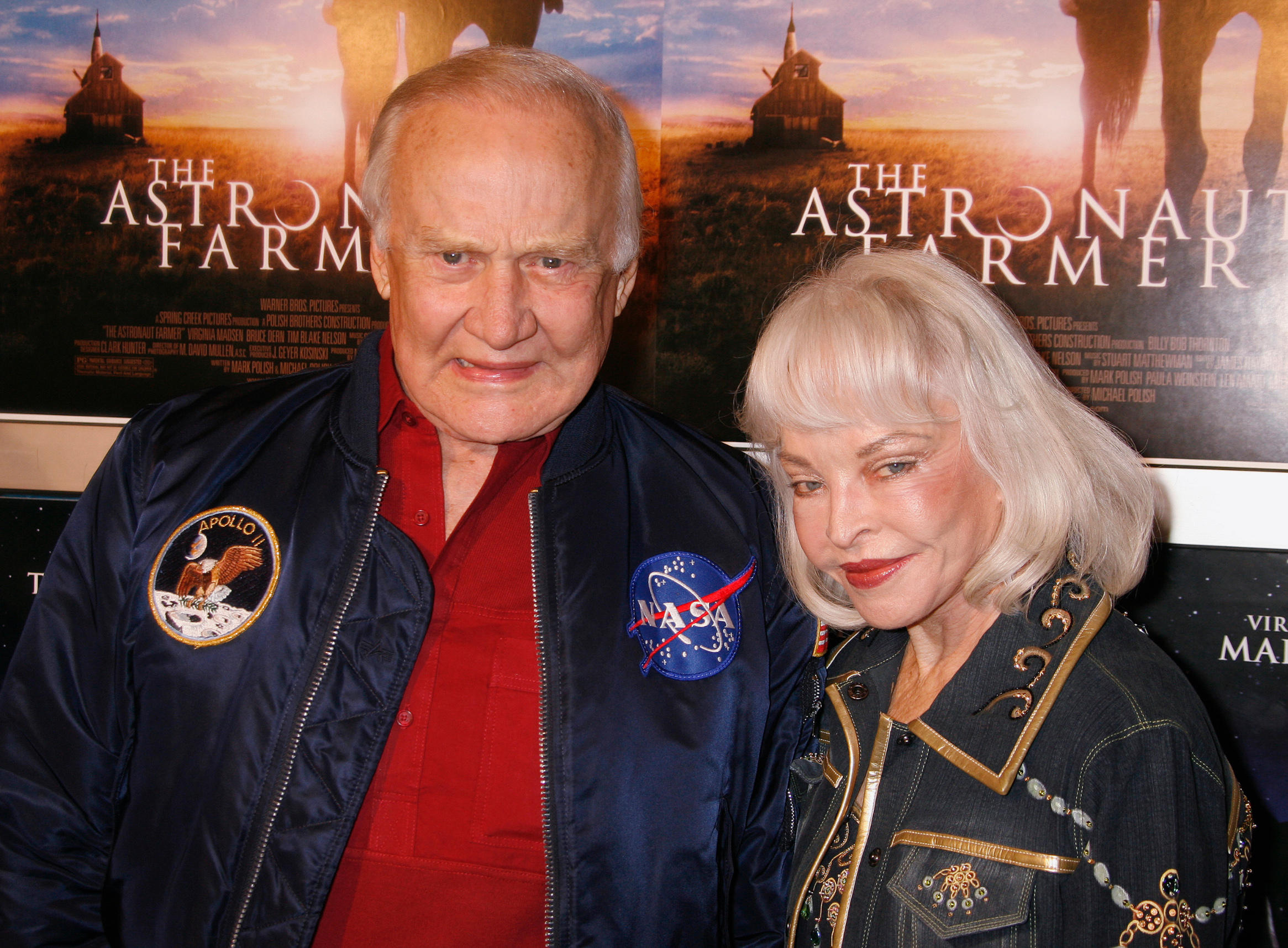 Former NASA astronaut Buzz Aldrin (L) and wife Lois pose as they arrive as guests at the premiere of the film 'The Astronaut Farmer' in Los Angeles February 20, 2007. Aldrin, a crew member of the Apollo 11 mission, was the second man to walk on the Moon on July 20, 1969, when the Apollo 11 Lunar Module landed on the moon's Sea of Tranquility. REUTERS/Fred Prouser     (UNITED STATES) - GM1DUQTZUEAA