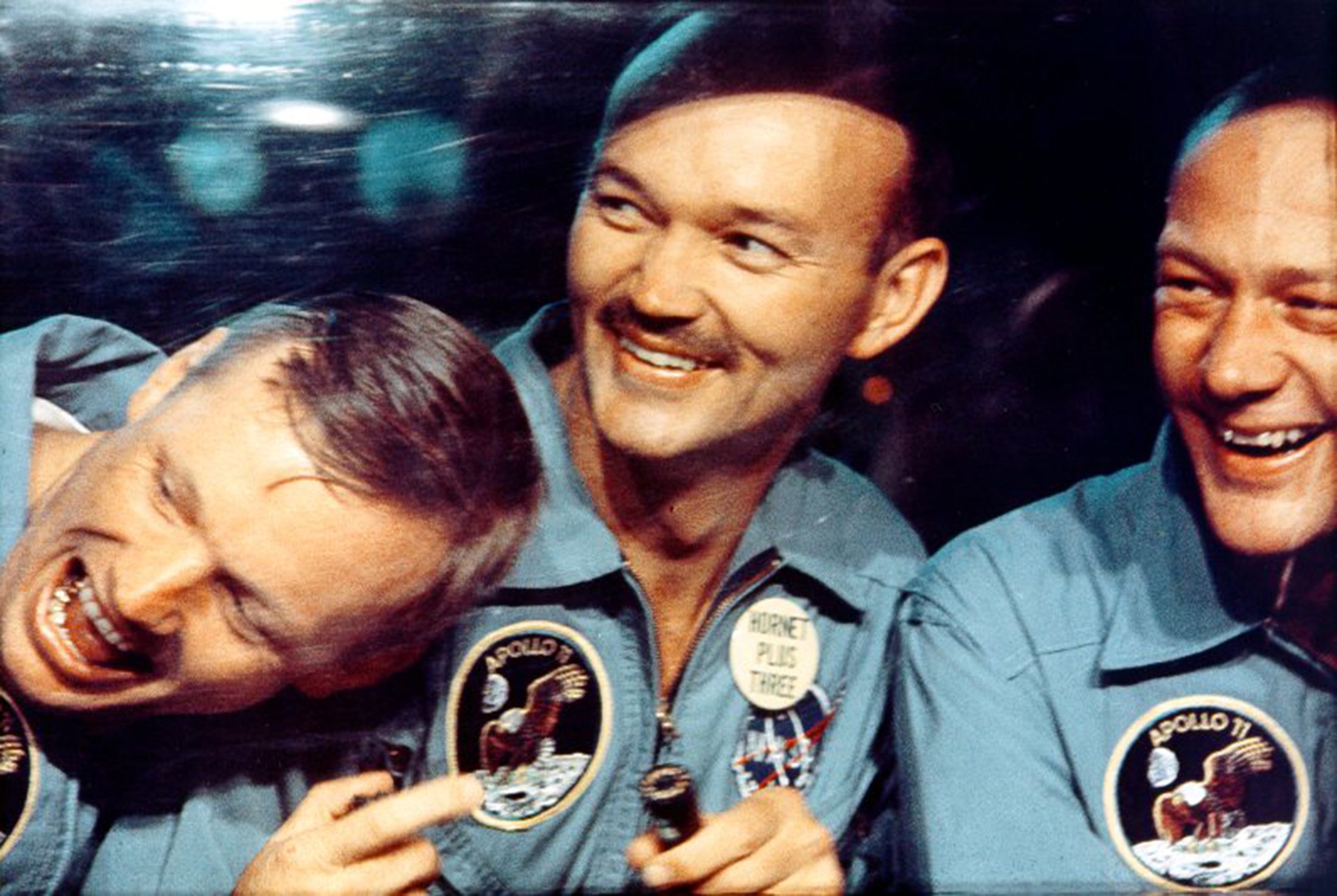 Apollo 11 astronauts Neil Armstrong (L), Michael Collins and Buzz Aldrin smile through the window of the mobile quarantine van in this NASA handout image dated July 24, 1969. REUTERS/NASA/Handout (UNITED STATES - Tags: SCIENCE TECHNOLOGY) FOR EDITORIAL USE ONLY. NOT FOR SALE FOR MARKETING OR ADVERTISING CAMPAIGNS. THIS IMAGE HAS BEEN SUPPLIED BY A THIRD PARTY. IT IS DISTRIBUTED, EXACTLY AS RECEIVED BY REUTERS, AS A SERVICE TO CLIENTS - TM3E88S1AFY01