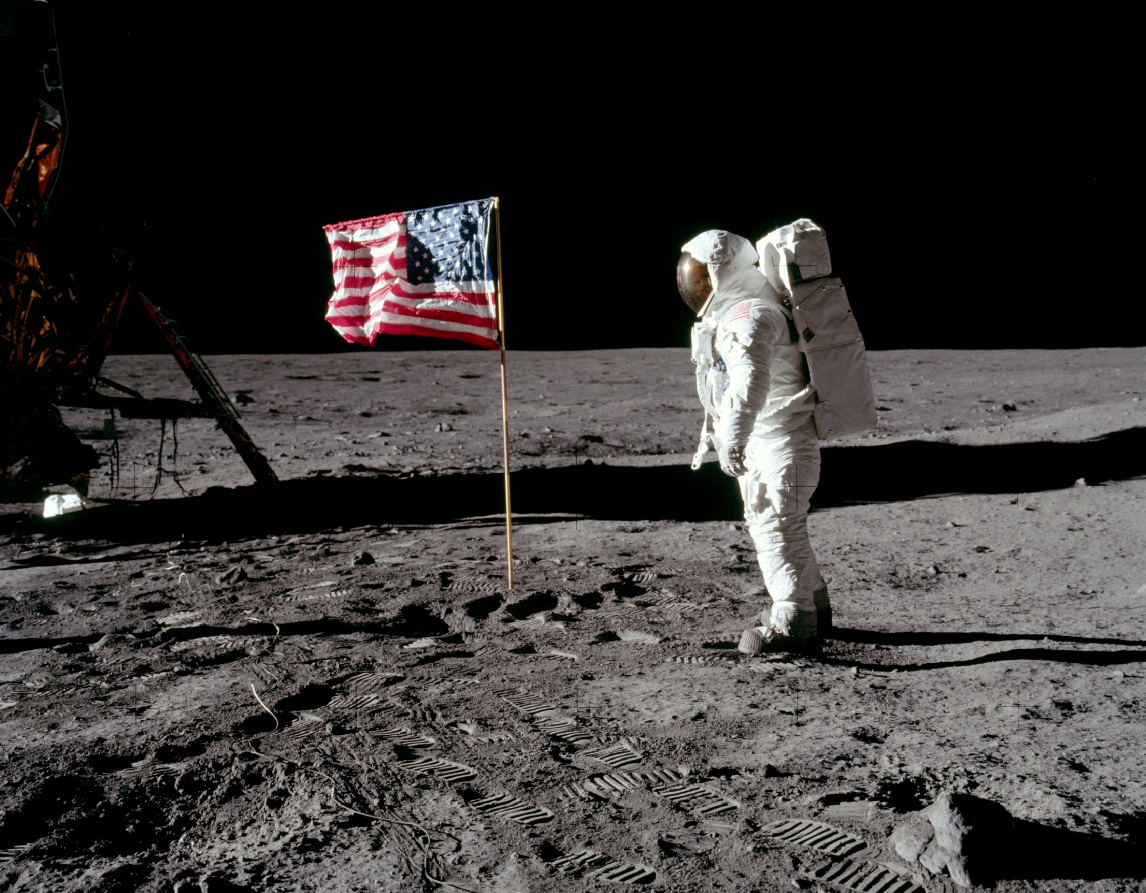 Astronaut Buzz Aldrin, lunar module pilot for Apollo 11, poses for a photograph beside the deployed United States flag during an extravehicular activity (EVA) on the moon, July 20, 1969. The lunar module (LM) is on the left, and the footprints of the astronauts are visible in the soil. Neil Armstrong/NASA/Handout via REUTERS   ATTENTION EDITORS - THIS IMAGE HAS BEEN SUPPLIED BY A THIRD PARTY - RC13872C90A0