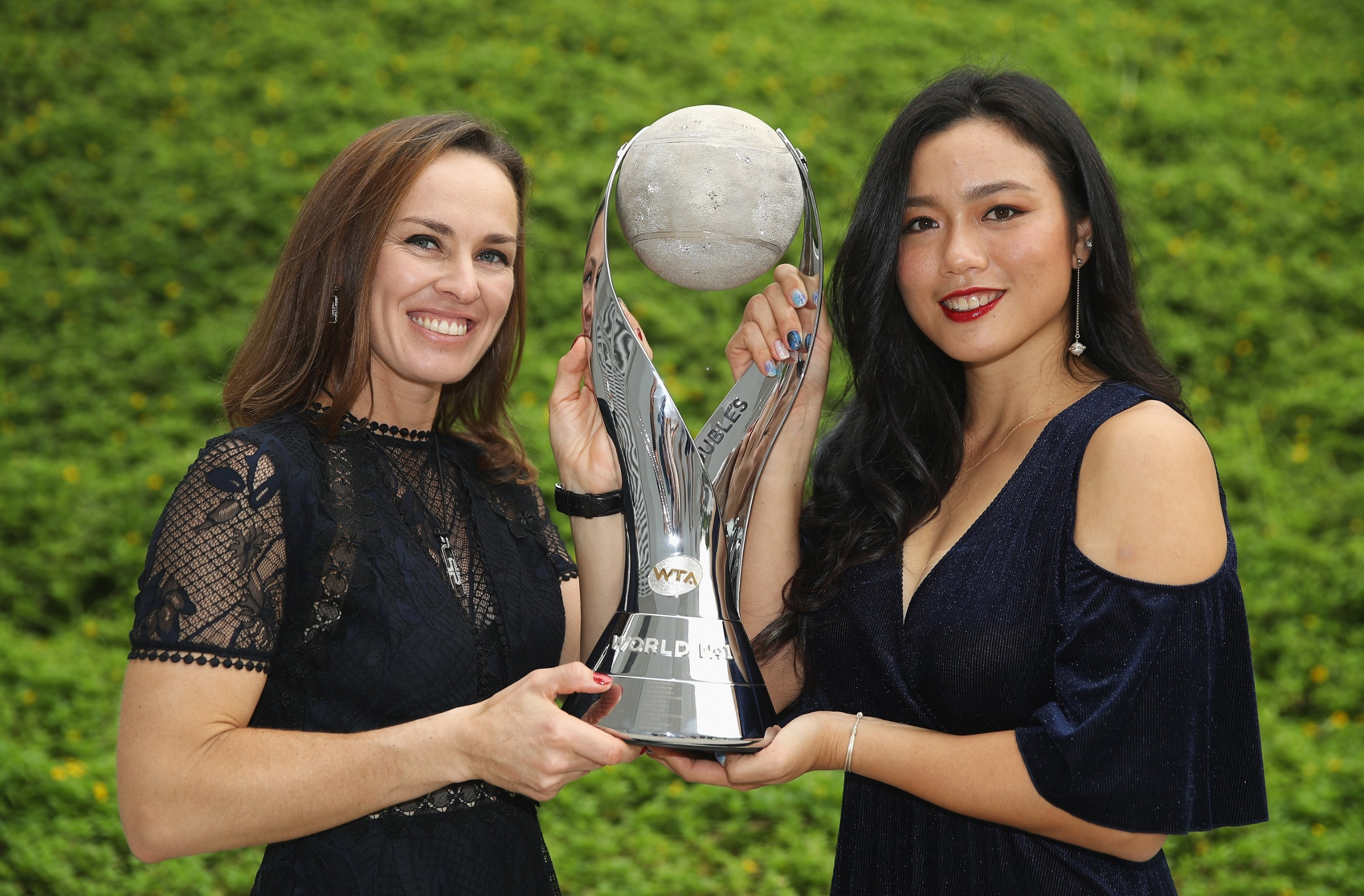 SINGAPORE - OCTOBER 24:  Martina Hingis (L) of Switzerland and Chan Yung-Jan of Chinese Taipei pose with the WTA World No.1 Doubles trophy during day 3 of the BNP Paribas WTA Finals Singapore presented by SC Global at Singapore Sports Hub on October 24, 2017 in Singapore.  (Photo by Julian Finney/Getty Images for WTA)