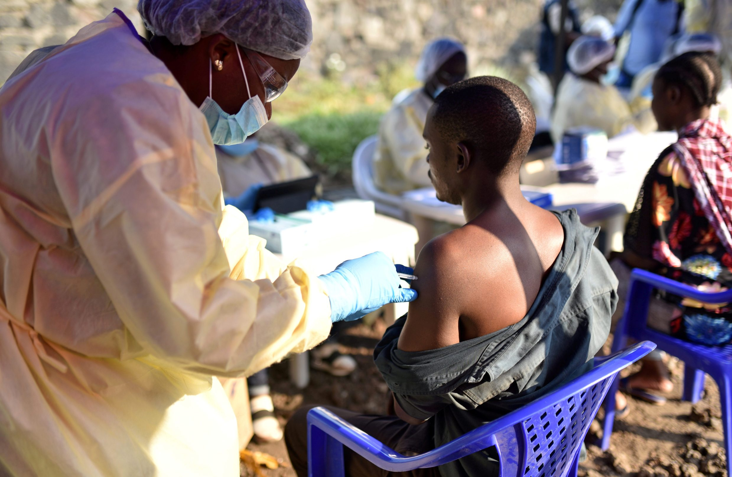 REFILE - CORRECTING STYLE A Congolese health worker administers an ebola vaccine to a man at the Himbi Health Centre in Goma, Democratic Republic of Congo, July 17, 2019. REUTERS/Olivia Acland