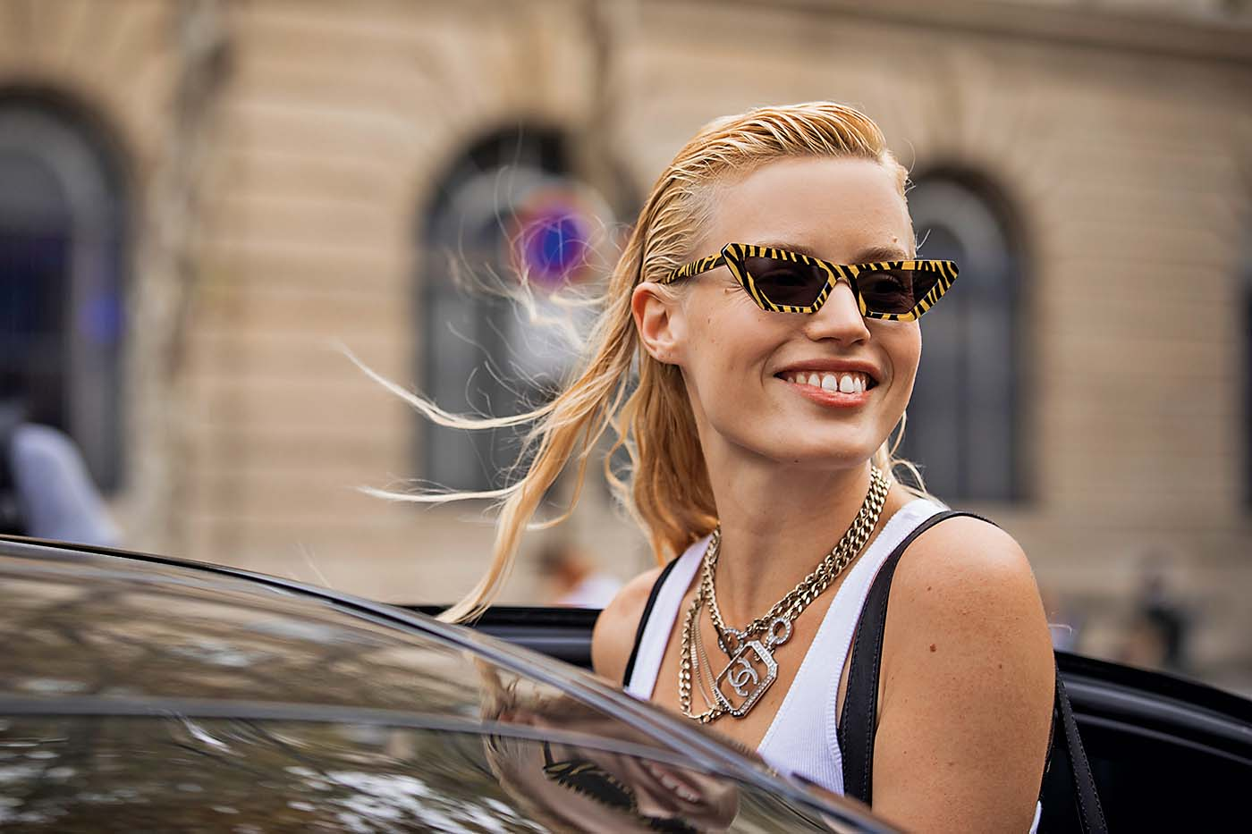 PARIS, FRANCE - SEPTEMBER 28:  Georgia May Jagger, wearing tiger print sunglasses, Chanel necklace, white top and black mini skirt, is seen after the Balmain show on September 28, 2018 in Paris, France. (Photo by Claudio Lavenia/Getty Images)