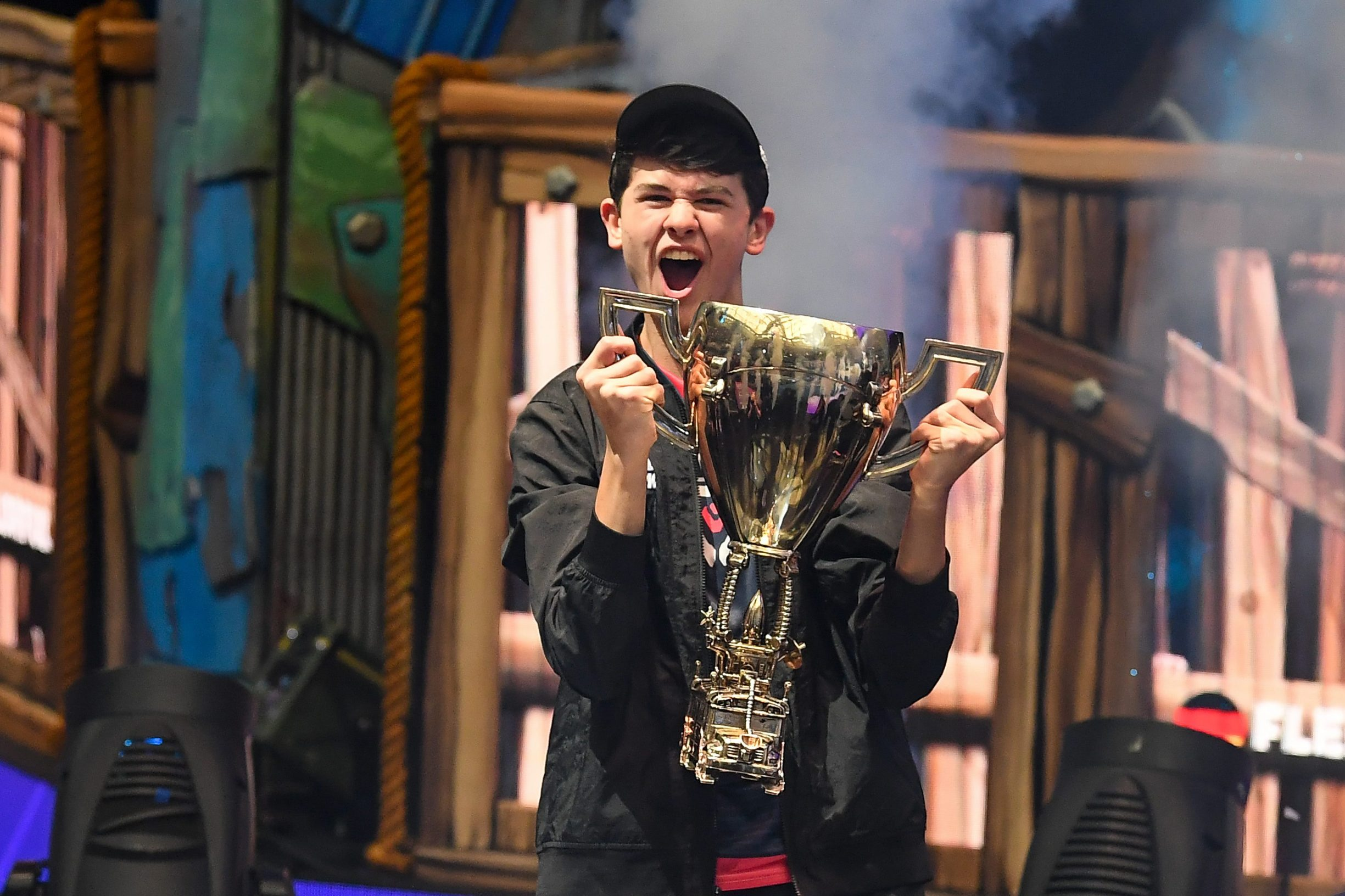 Jul 28, 2019; Flushing, NY, USA; Bugha celebrates his win as the first solo World Champion at the Fortnite World Cup Finals e-sports event at Arthur Ashe Stadium. Mandatory Credit: Dennis Schneidler-USA TODAY Sports