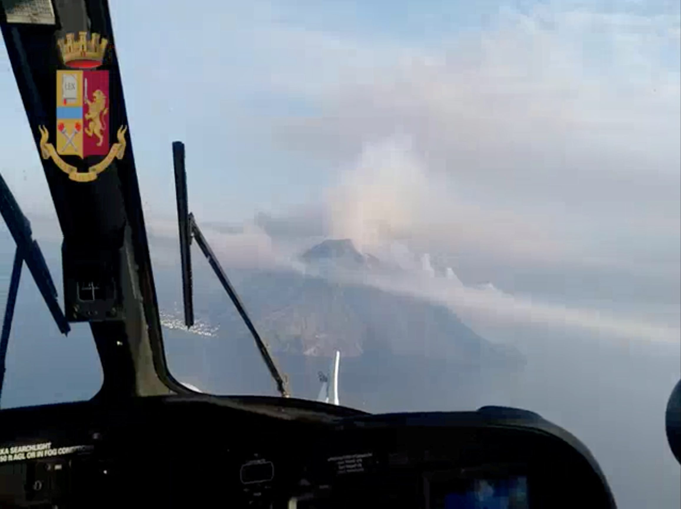 REFILE - QUALITY REPEAT An aerial still image taken from police helicopter video shows ash and smoke rising after a volcanic eruption, seen over Stromboli, Italy July 3, 2019. Polizia di Stato/Handout via REUTERS ATTENTION EDITORS - THIS IMAGE HAS BEEN SUPPLIED BY A THIRD PARTY.
