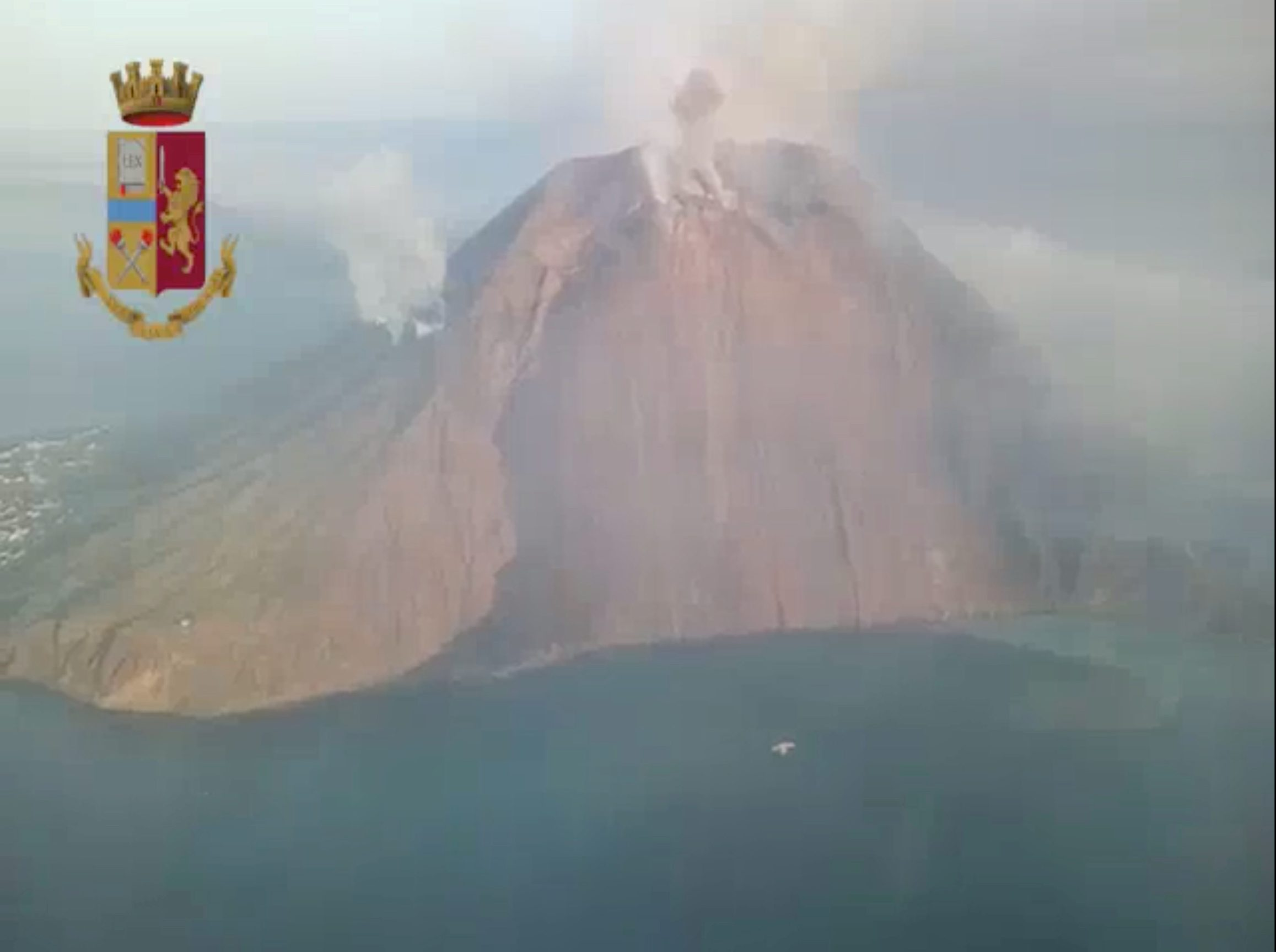 REFILE - QUALITY REPEAT An aerial still image taken from police helicopter video shows ash and smoke rising after a volcanic eruption, seen over Stromboli, Italy July 3, 2019. Coat of arms graphic added at source. Polizia di Stato/Handout via REUTERS ATTENTION EDITORS - THIS IMAGE HAS BEEN SUPPLIED BY A THIRD PARTY.