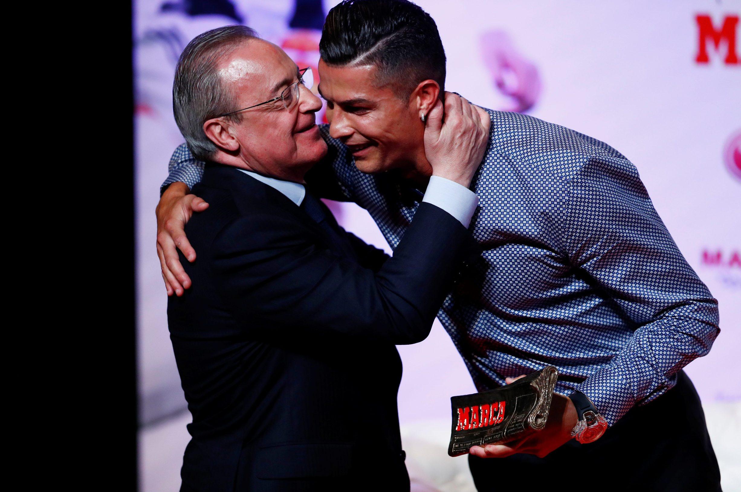 Soccer Football - Cristiano Ronaldo receives the MARCA Legend award - Reina Victoria Theater, Madrid, Spain - July 29, 2019   Cristiano Ronaldo embraces Real Madrid president Florentino Perez during the presentation   REUTERS/Juan Medina