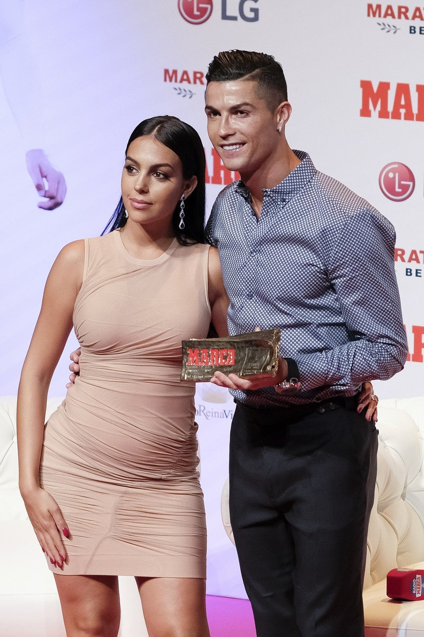 July 30, 2019, Madrid, Spain: Cristiano Ronaldo and Georgina Rodriguez posing to media with 'Marca Leyenda' award on July 29, 2019 in Madrid, Spain. The award is attributed to sport professionals by the Spanish sports newspaper MARCA., Image: 461426147, License: Rights-managed, Restrictions: * France Rights OUT *, Model Release: no, Credit line: Profimedia, Zuma Press