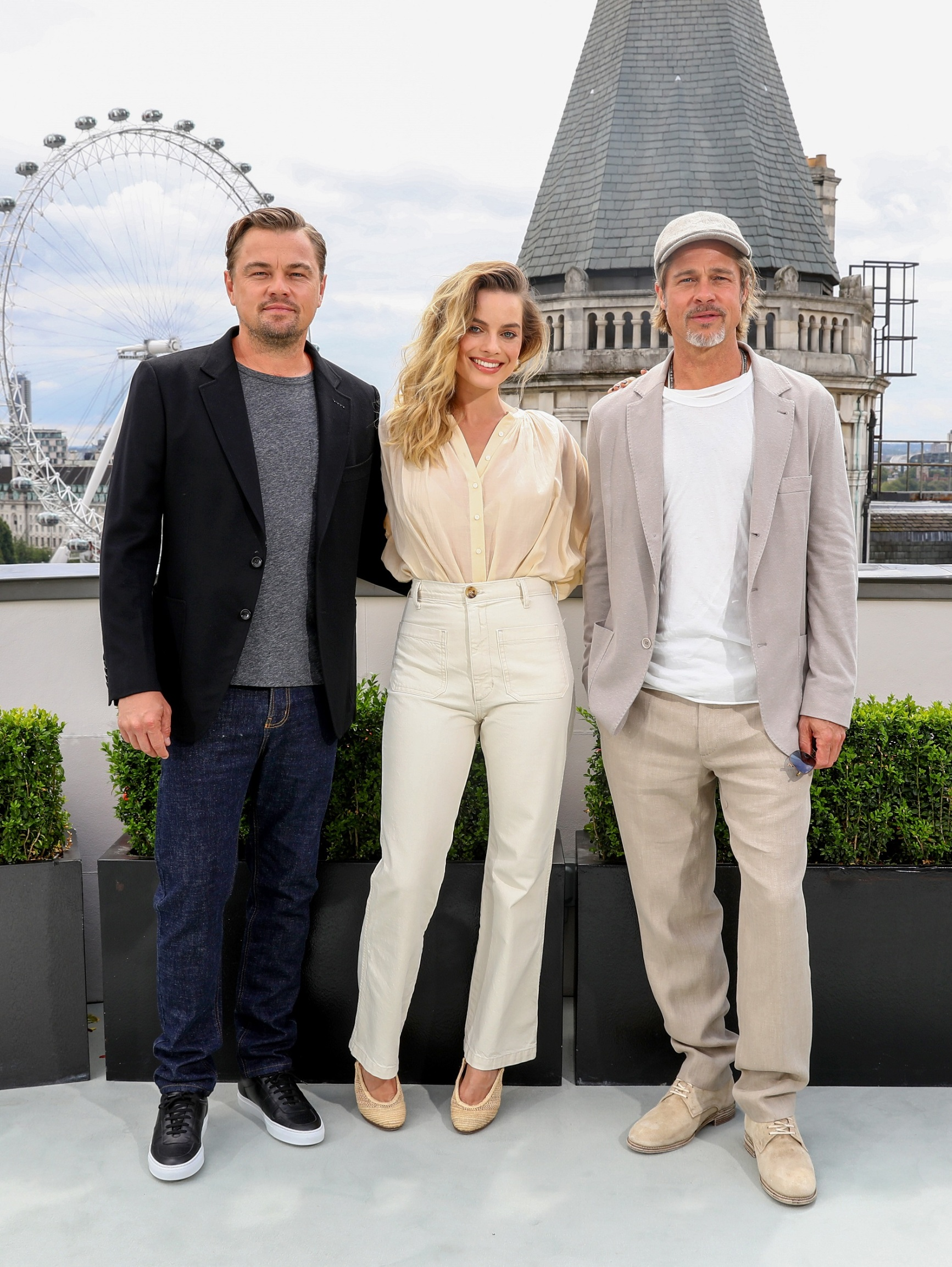 LONDON, ENGLAND - JULY 31:  (L-R) Leonardo DiCaprio, Margot Robbie and Brad Pitt attend the Once Upon A Time…In Hollywood Photocall in London at The Corinthia Hotel on July 31, 2019 in London, England. (Photo by Tim P. Whitby/Getty Images for Sony)