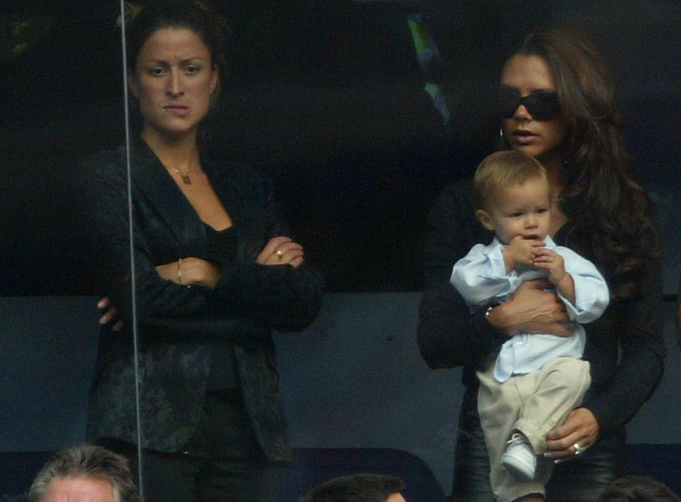 MADRID, SPAIN - SEPTEMBER 13: (FILE PHOTO)  Victoria Beckham holds son Romeo beside David Beckham's PA Rebecca Loos during the Spanish Primera Liga match between Real Madrid and Valladolid at the Santiago Bernabeu Stadium on September 13, 2003 in Madrid, Spain. David Beckham and former PA Rebecca Loos are under scrutiny for an alleged affair, reported by the News Of The World this weekend. (Photo by Shaun Botterill/Getty Images)
