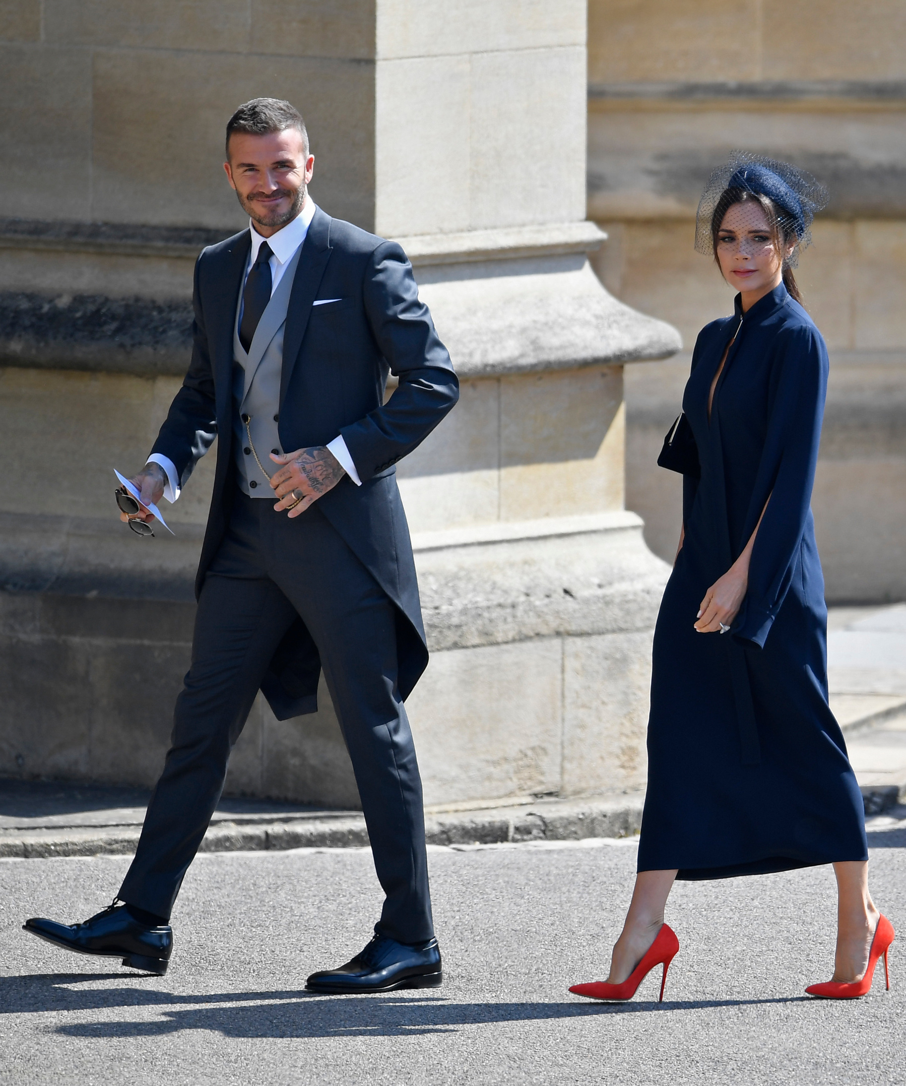 WINDSOR, UNITED KINGDOM - MAY 19:  David Beckham and Victoria Beckham arrive at St George's Chapel at Windsor Castle before the wedding of Prince Harry to Meghan Markle on May 19, 2018 in Windsor, England. (Photo by Toby Melville- WPA Pool/Getty Images)