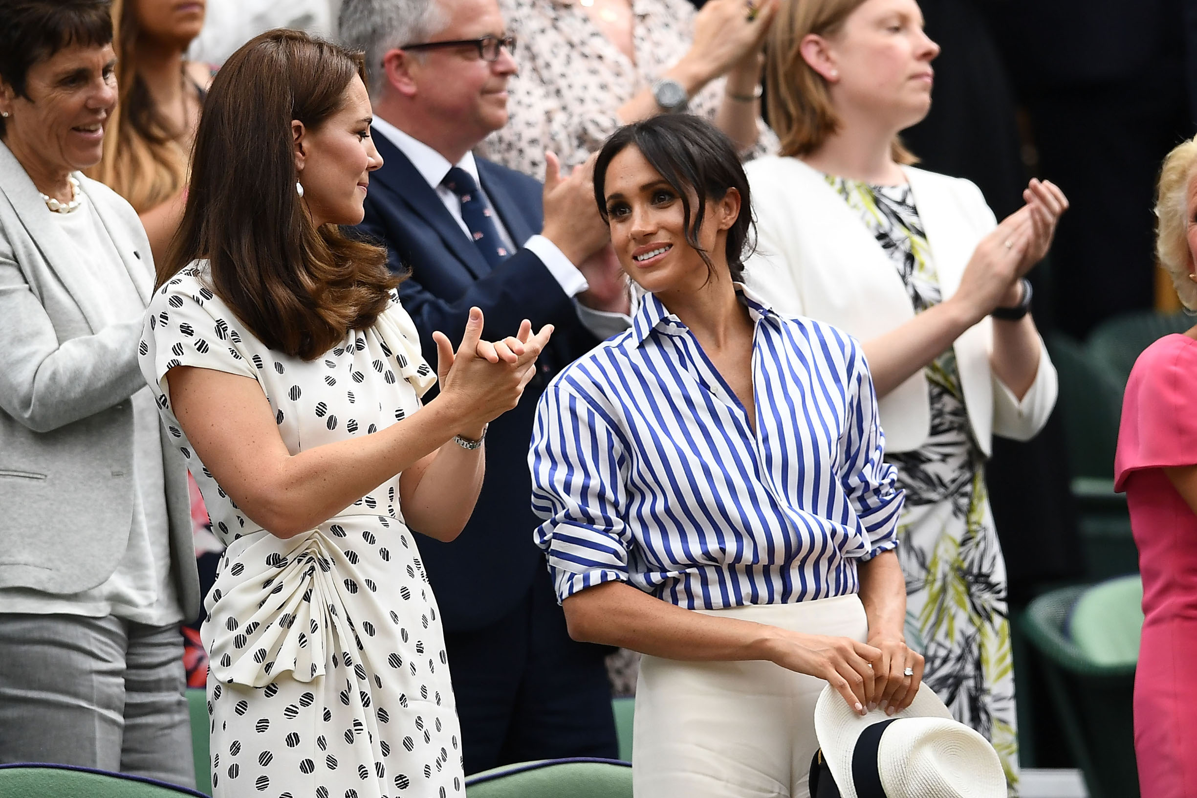 LONDON, ENGLAND - JULY 14:  Catherine, Duchess of Cambridge and Meghan, Duchess of Sussex react after Novak Djokovic of Serbia beat Rafael Nadal of Spain in the Men's Singles semi-final on day twelve of the Wimbledon Lawn Tennis Championships at All England Lawn Tennis and Croquet Club on July 14, 2018 in London, England.  (Photo by Clive Mason/Getty Images)