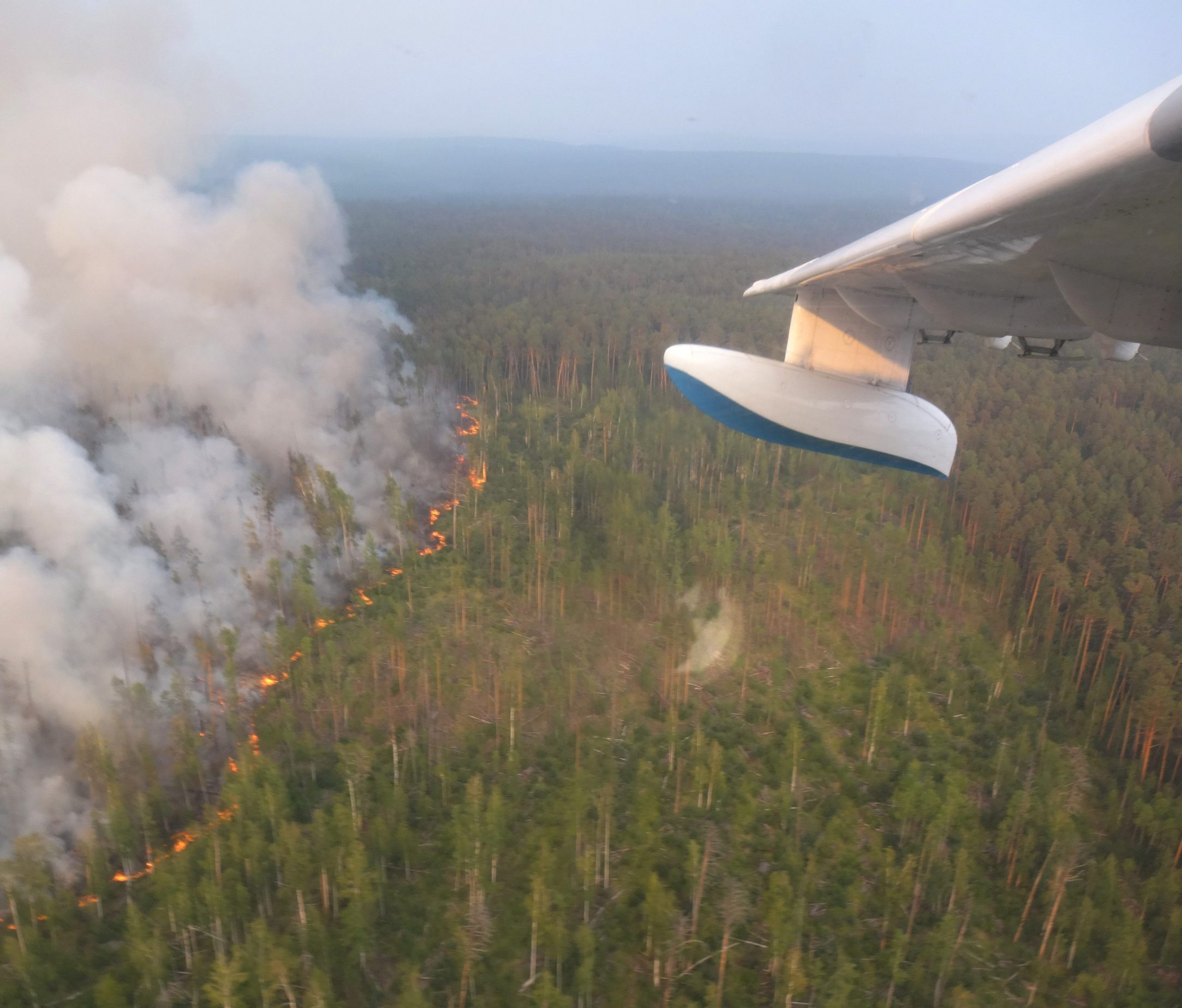 An aerial view through an aircraft window shows flame and smoke rising froma wildfire in Krasnoyarsk region, Russiain this handout picture obtained by Reuters on August 1, 2019. Russian Emergencies Ministry in Krasnoyarsk region/Handout via REUTERS ATTENTION EDITORS - THIS IMAGE WAS PROVIDED BY A THIRD PARTY. NO RESALES. NO ARCHIVES. MANDATORY CREDIT.